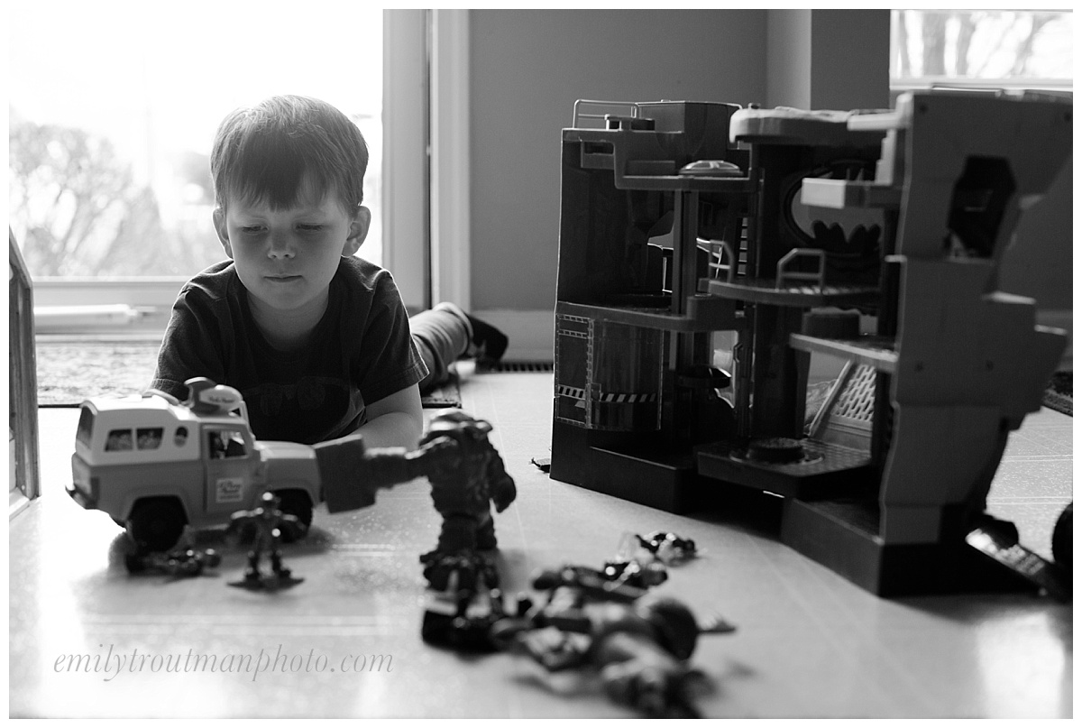 """This was pre-haircut last week. He had set up his Batman cave and """"joes,"""" as he calls them by the front door to play. Loved the light and the angle. Sometimes in a family of 6, you have to get creative for where you can get yourself some space!"""