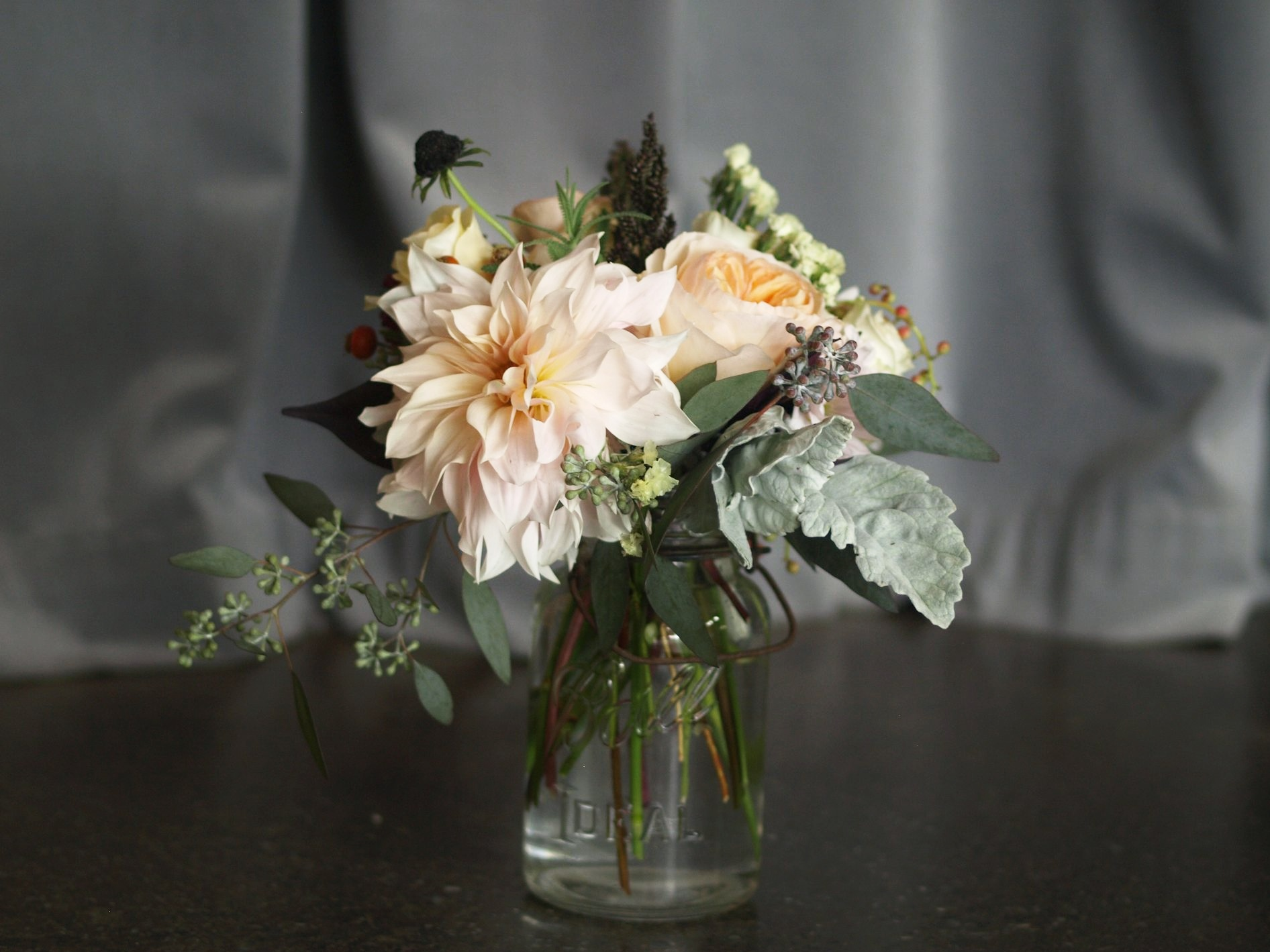 Oreonta house woodstock wedding vintage mason ball jar centerpiece with garden rose dahlia dusty miller scabiosa grey greens and wildflowers rosehip social rosehip floral.jpg