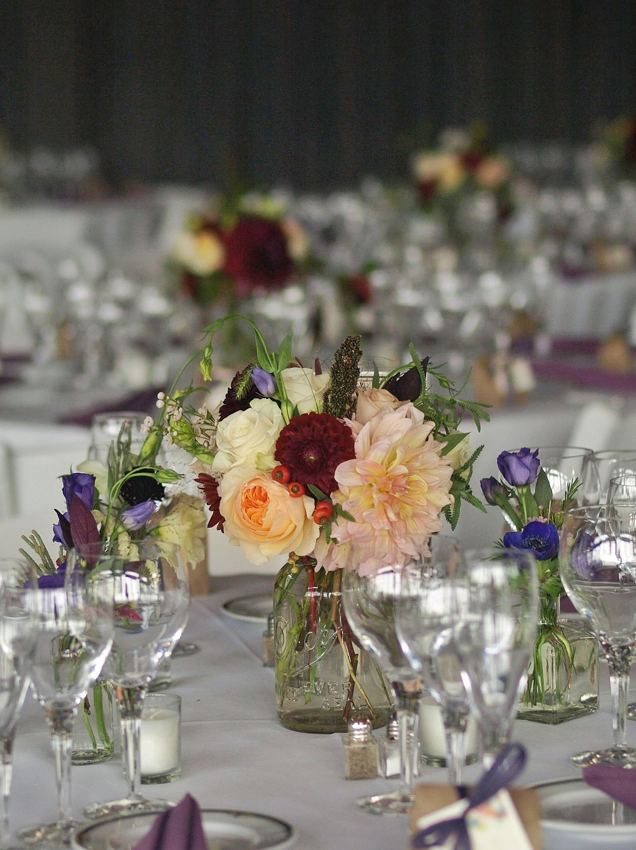 Oreonta house woodstock wedding mason jar centerpiece with garden rose dahlia and wildflowers 1.jpg
