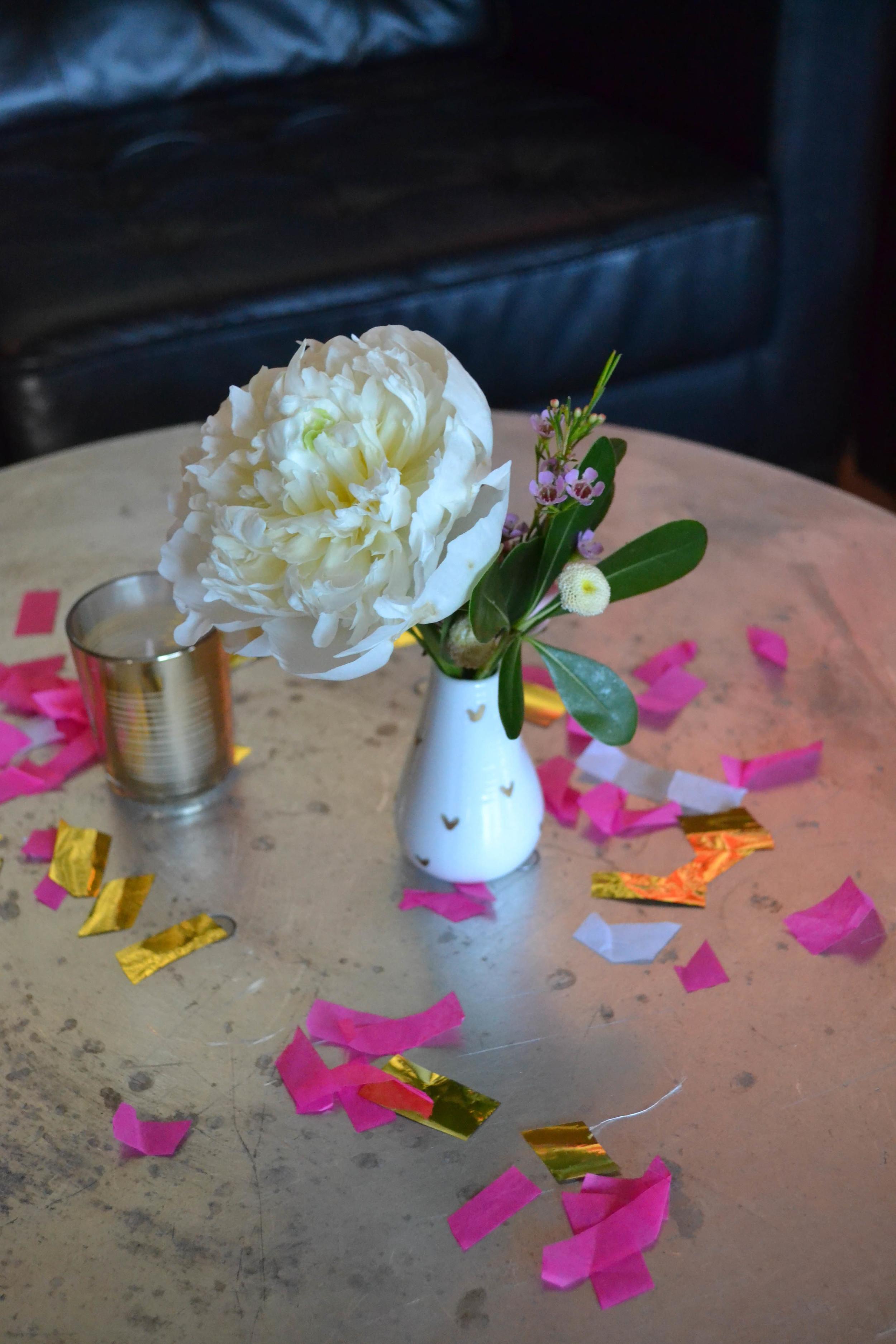 White bud vase arrangement in white ceramic vase.  Rosehip Social, Brooklyn, NY.