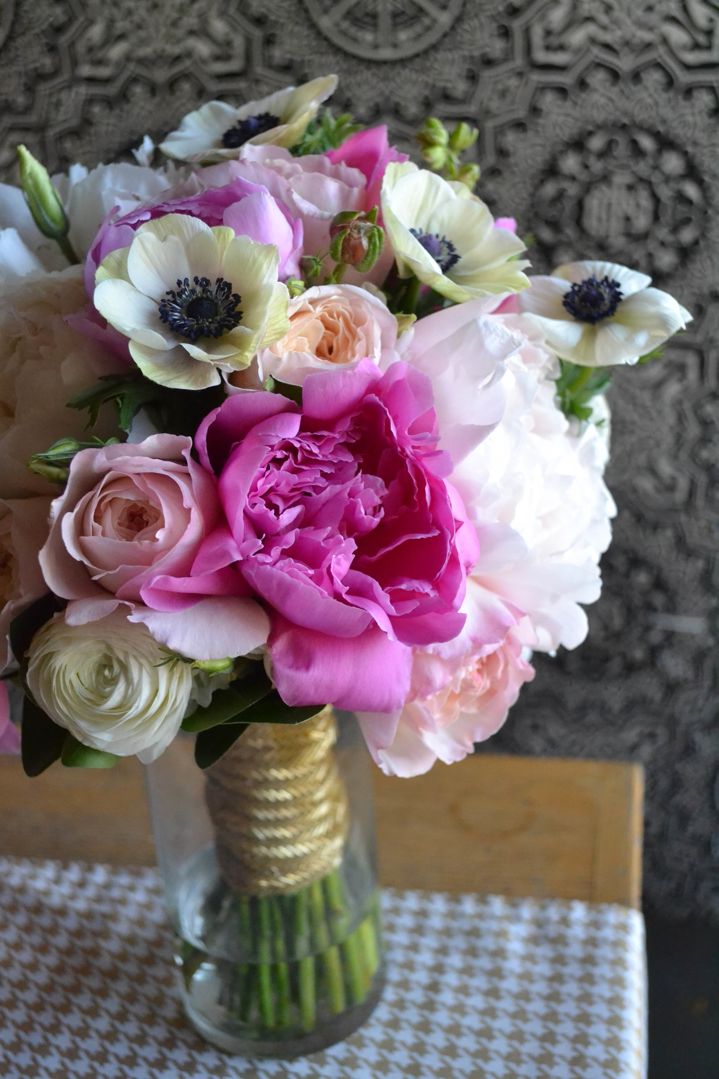 Bridal bouquet of pink and white radunculus and anemones.  Rosehip Social, Brooklyn, NY.