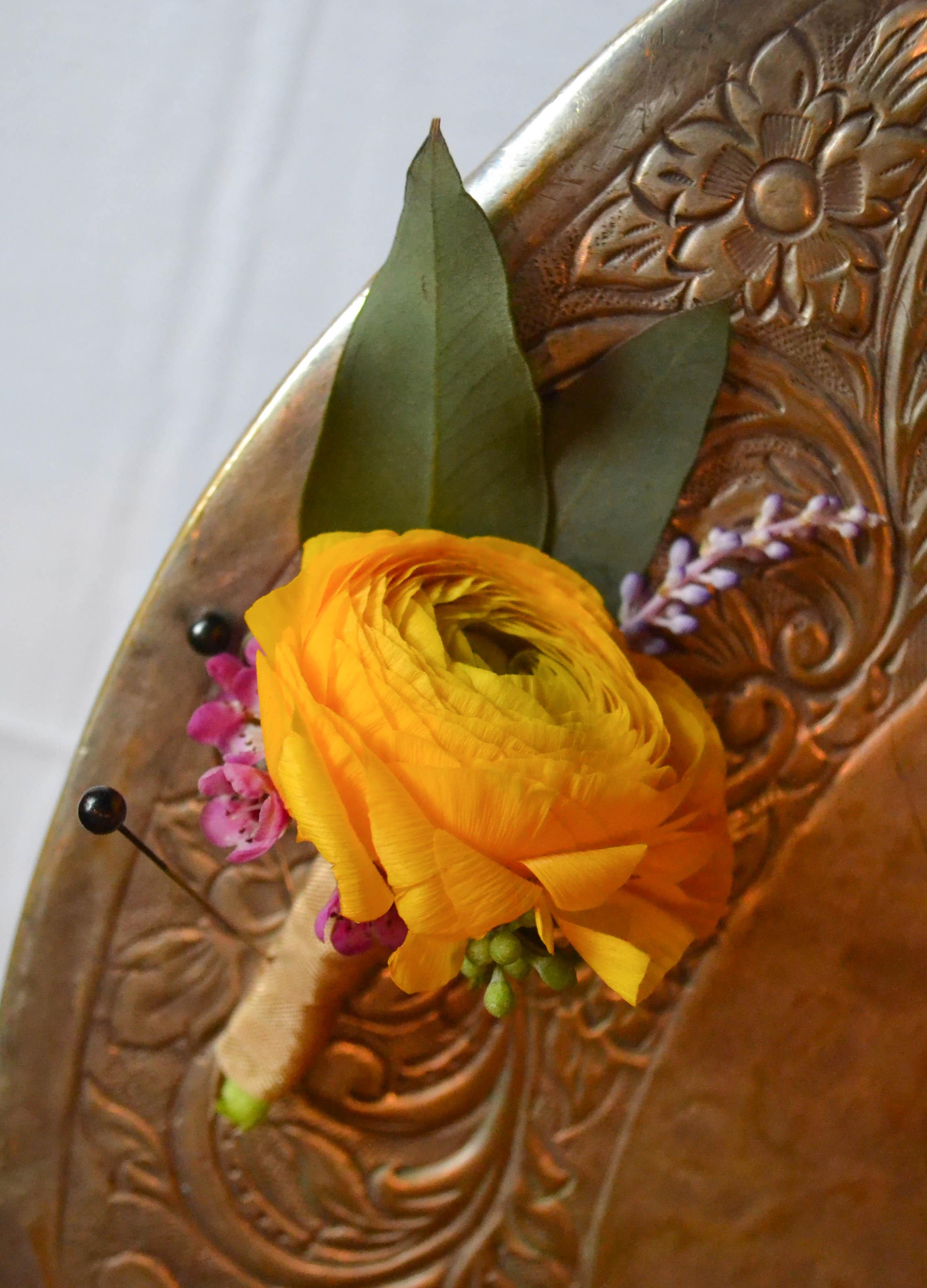 Yellow groom's boutoniere