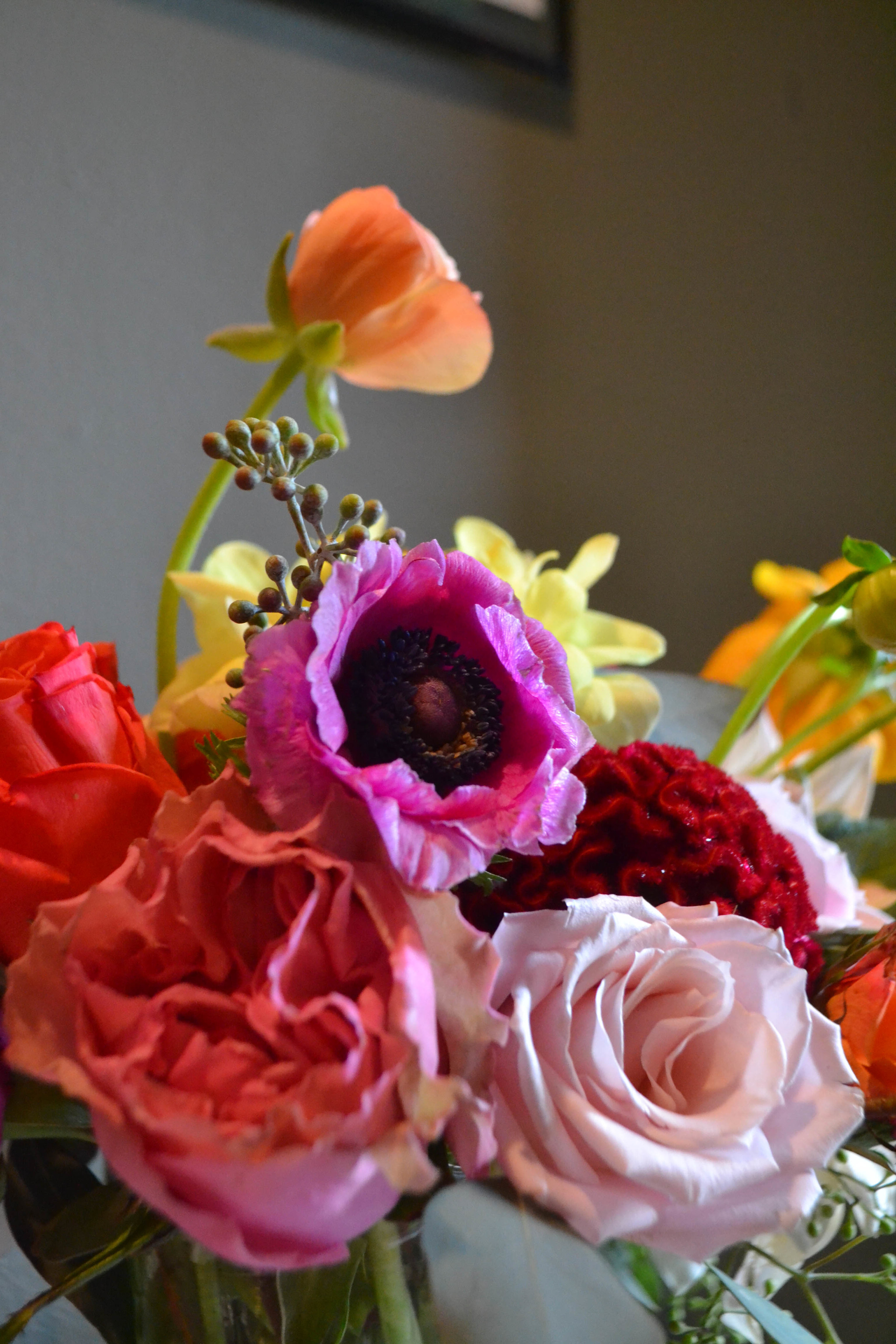 Colorful and romantic flower compote centerpiece closeup. Catskills wedding.