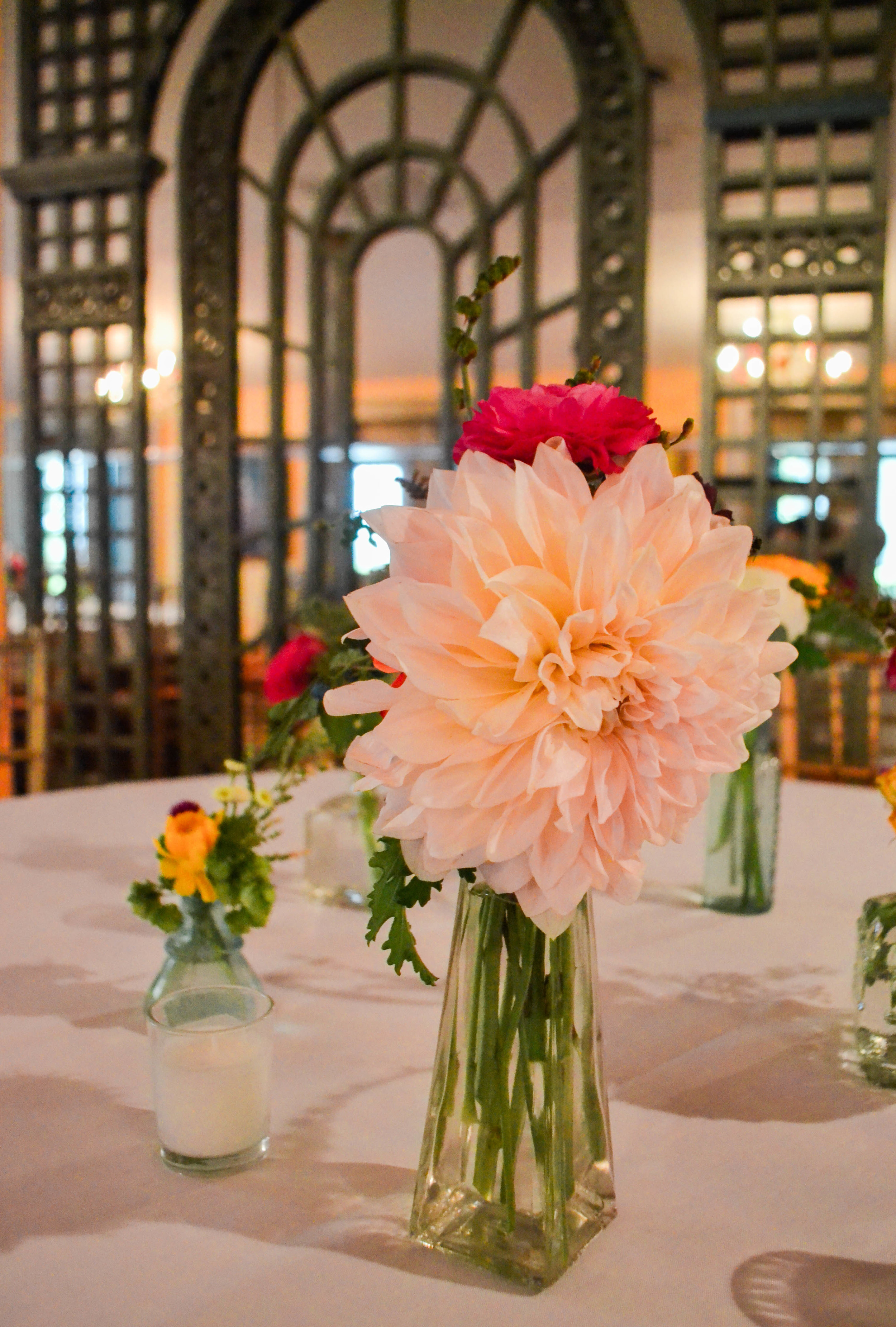 Colorful and romantic flower centerpiece in bud vase bottle. Catskills wedding. August.