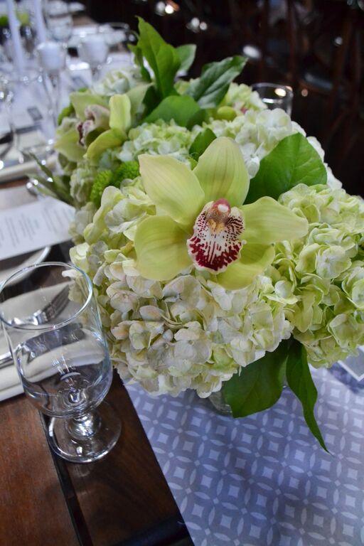 Green Cymbidium orchid and hydrangea centerpieces at MyMoon.  Rosehip Social, Brooklyn, NY.