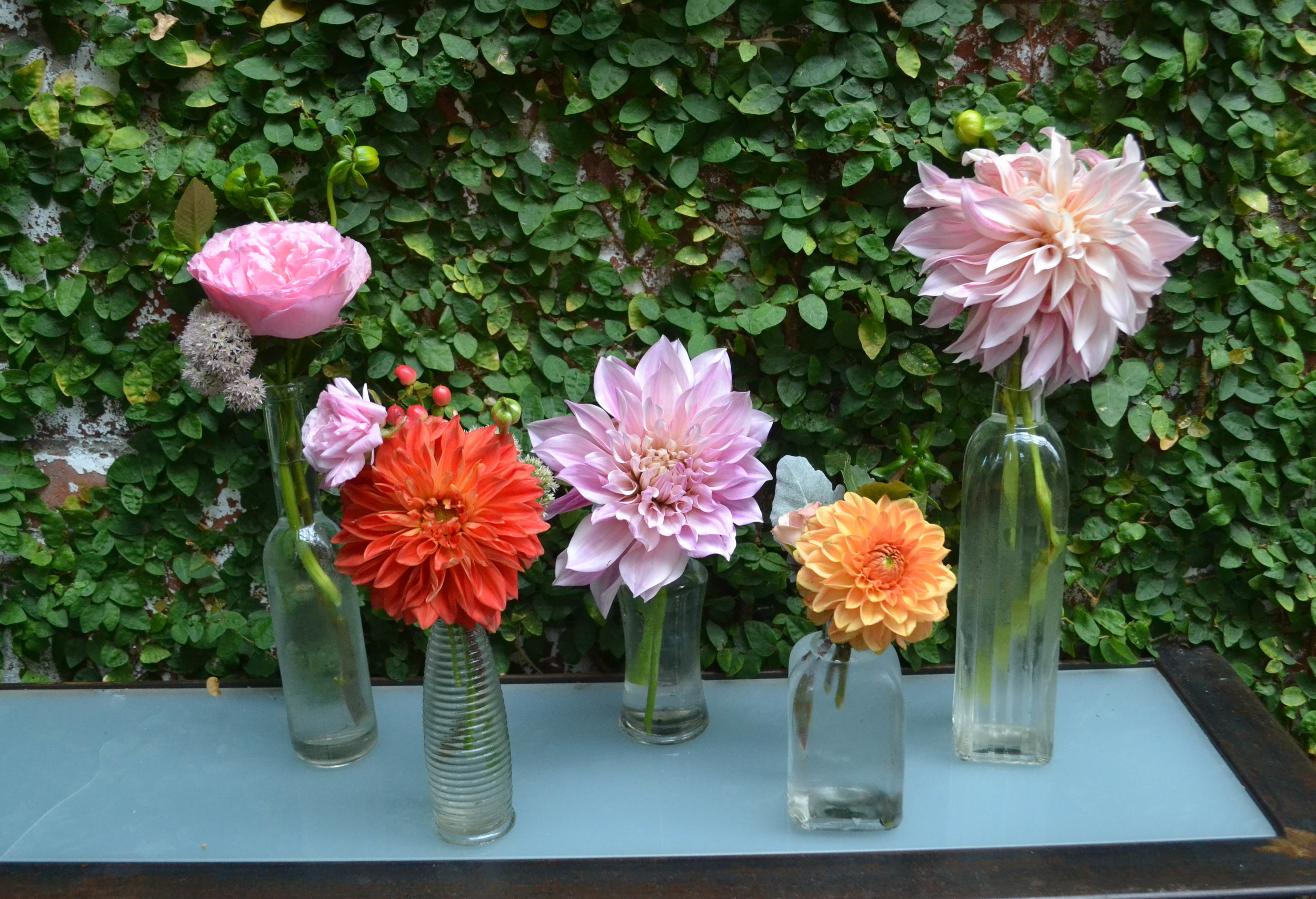 Bud vases filled with dahlias and garden roses. Foundry cocktail hour. LIC Wedding. Rosehip Social.