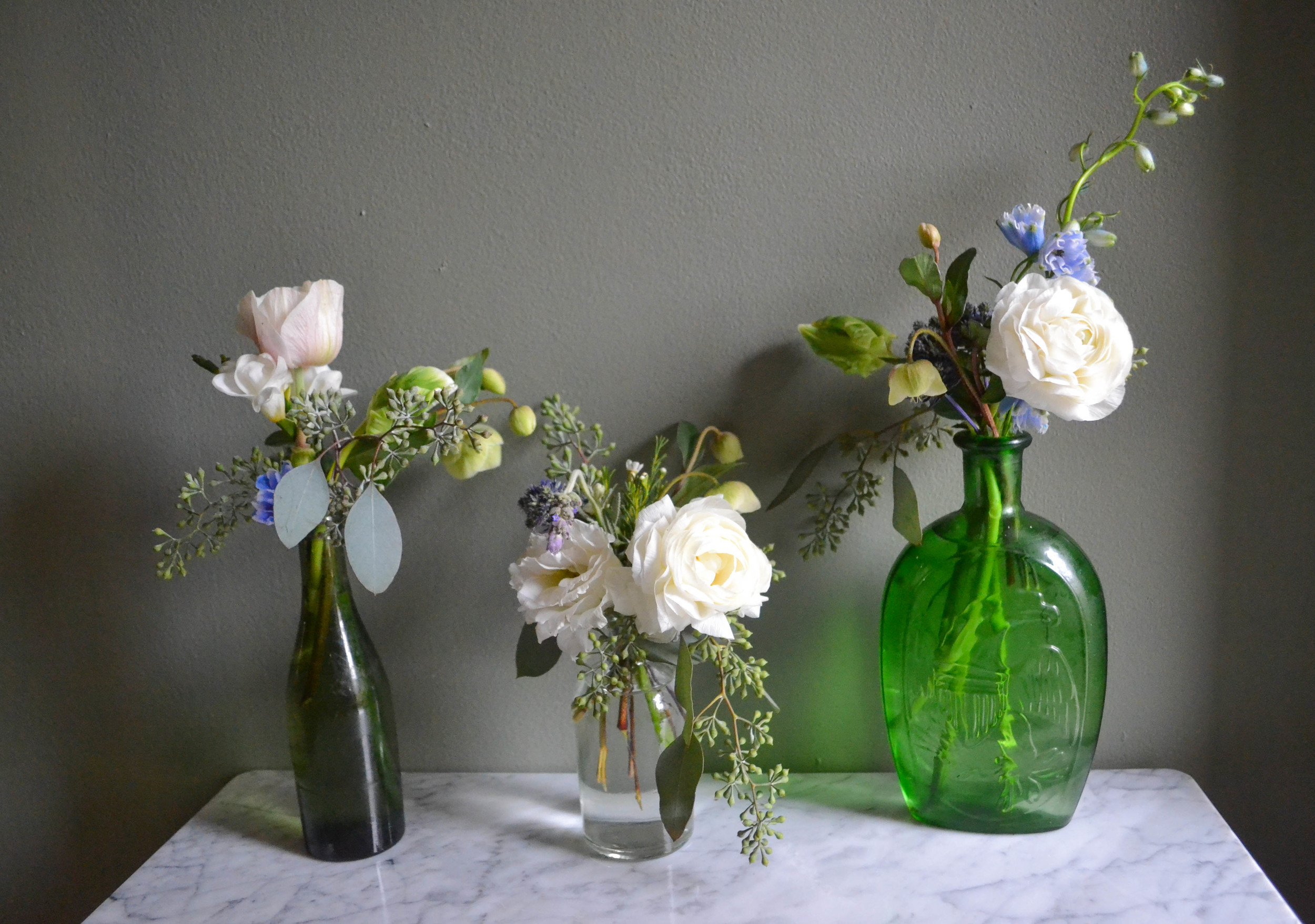 Green and white bud vase arrangements with blue and lavender accents. Baby Shower flowers for Garden Collage. Amaryllis, parrot tulip, jade green roses, ranunculus, lavender.