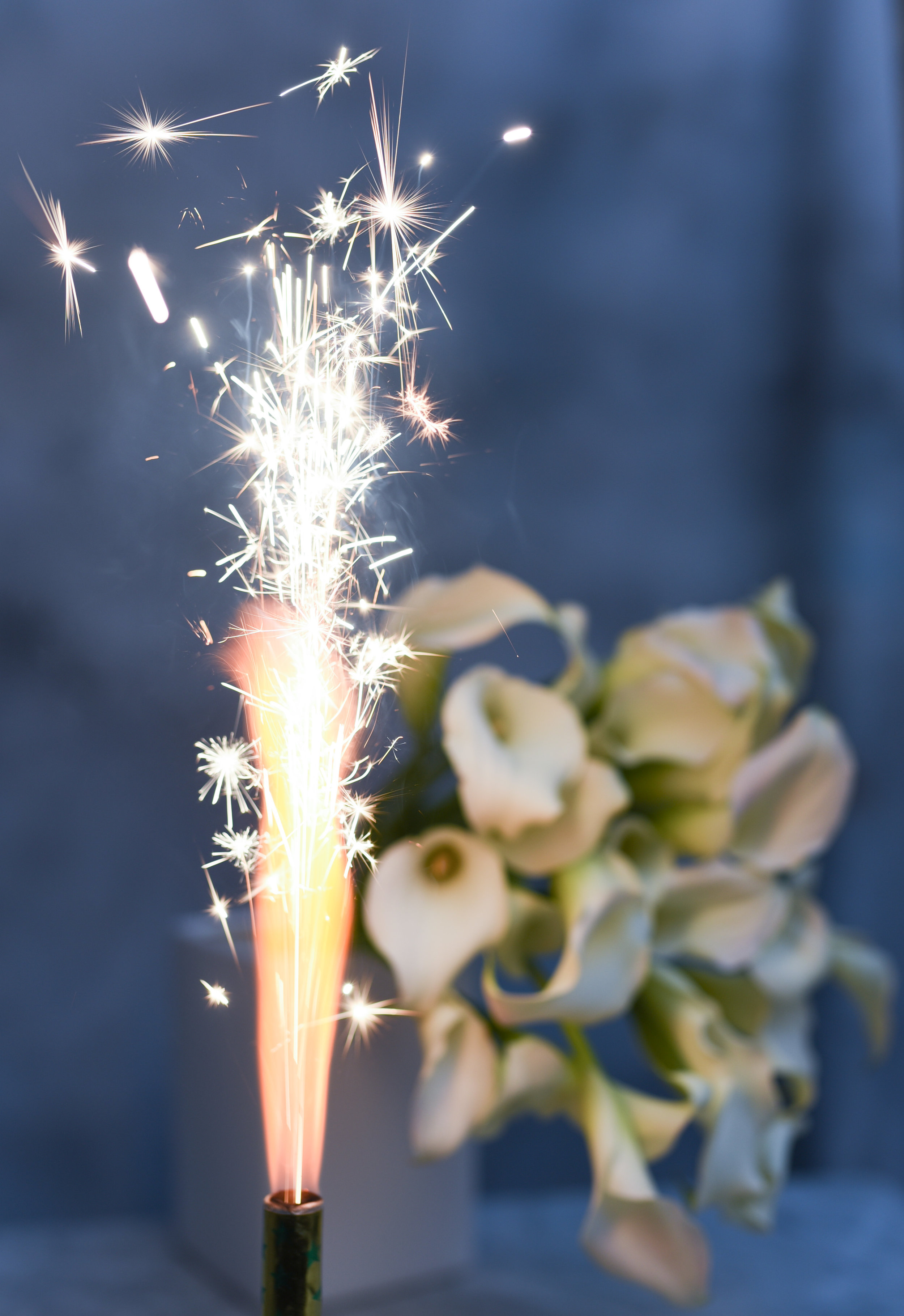 Sparkling New Years Eve wedding bouquets of calla lilies