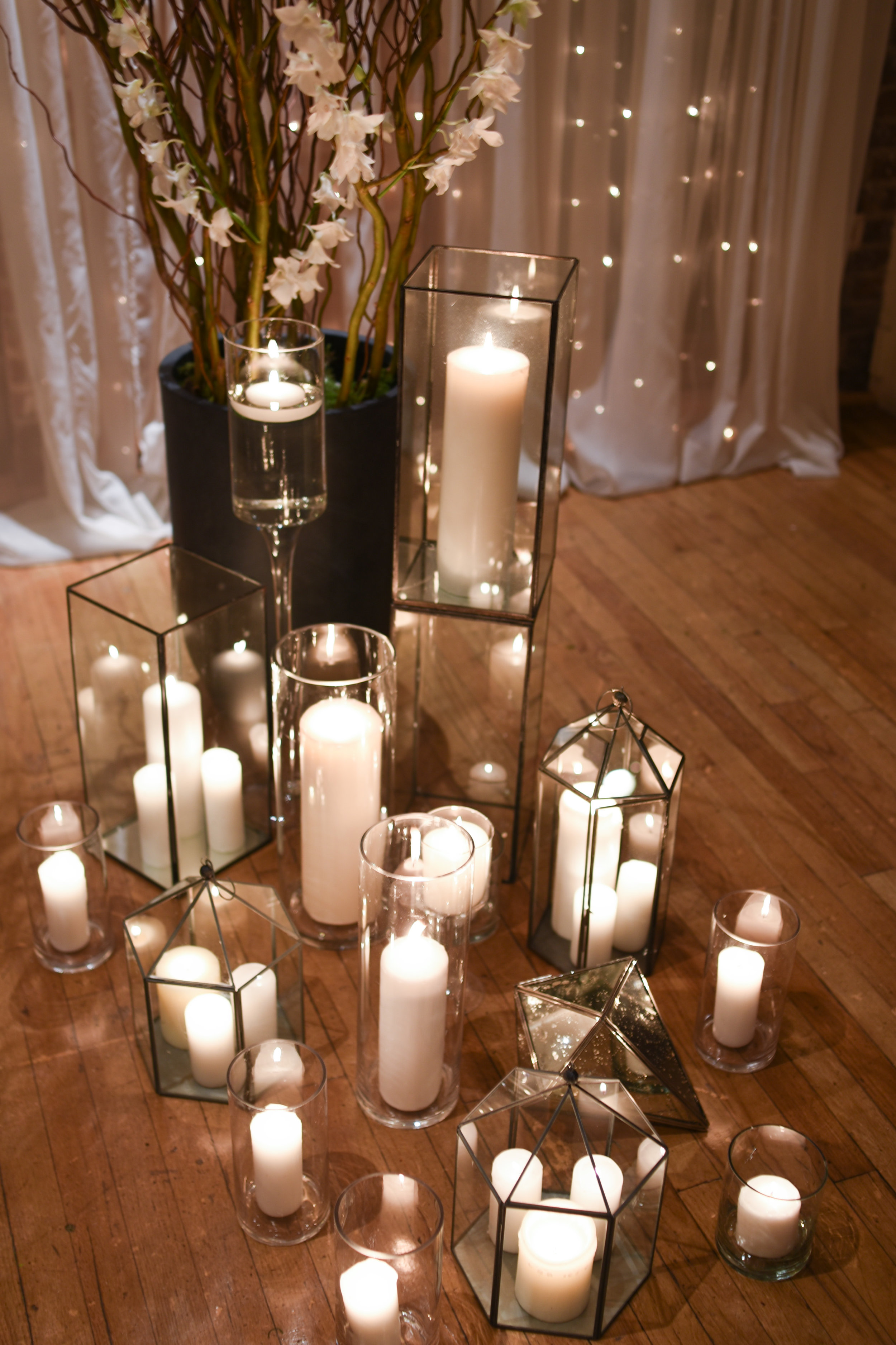 Massed candles glow with the happy couple at the NYE wedding