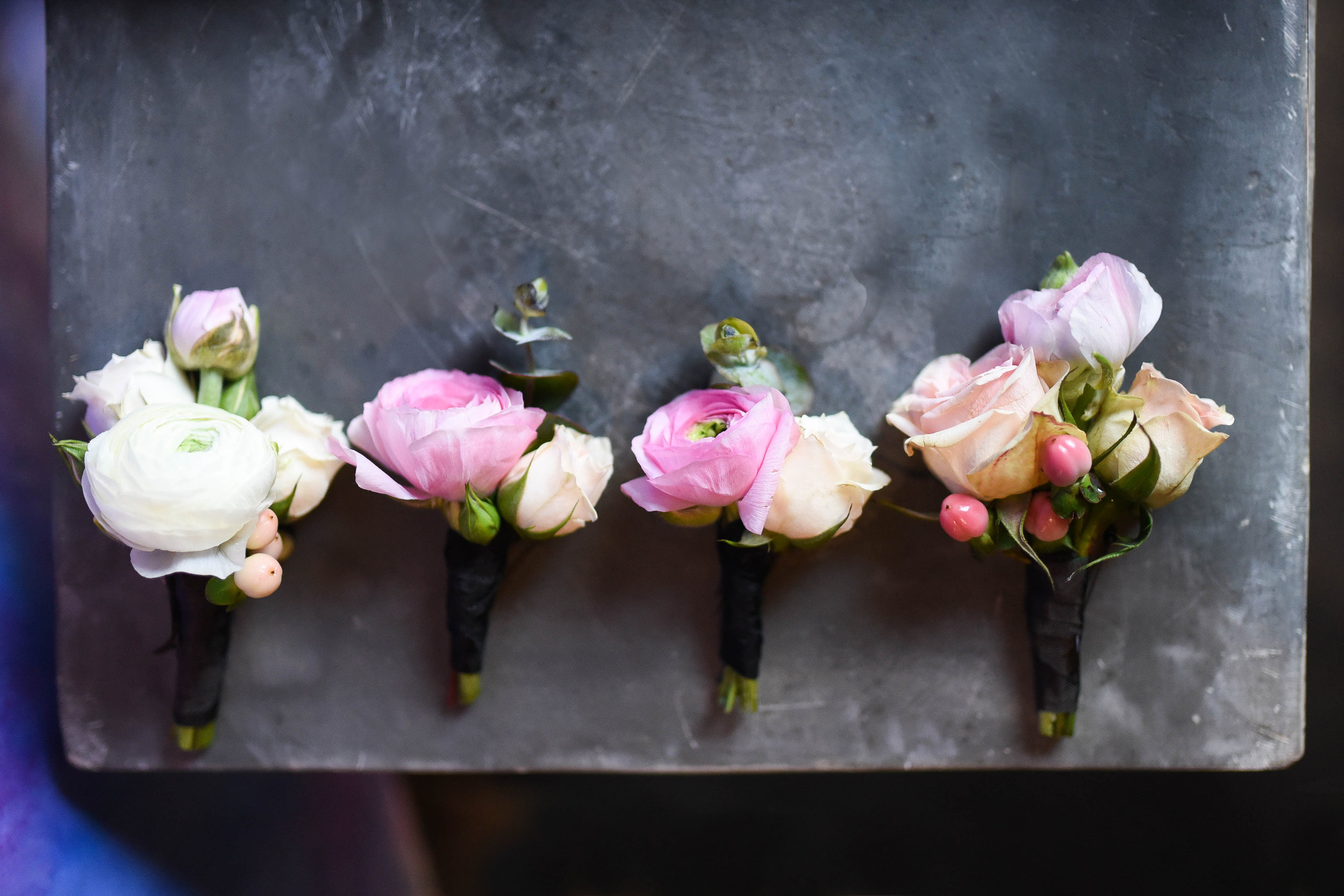 Boutonnieres for the groom and his men, all softly different