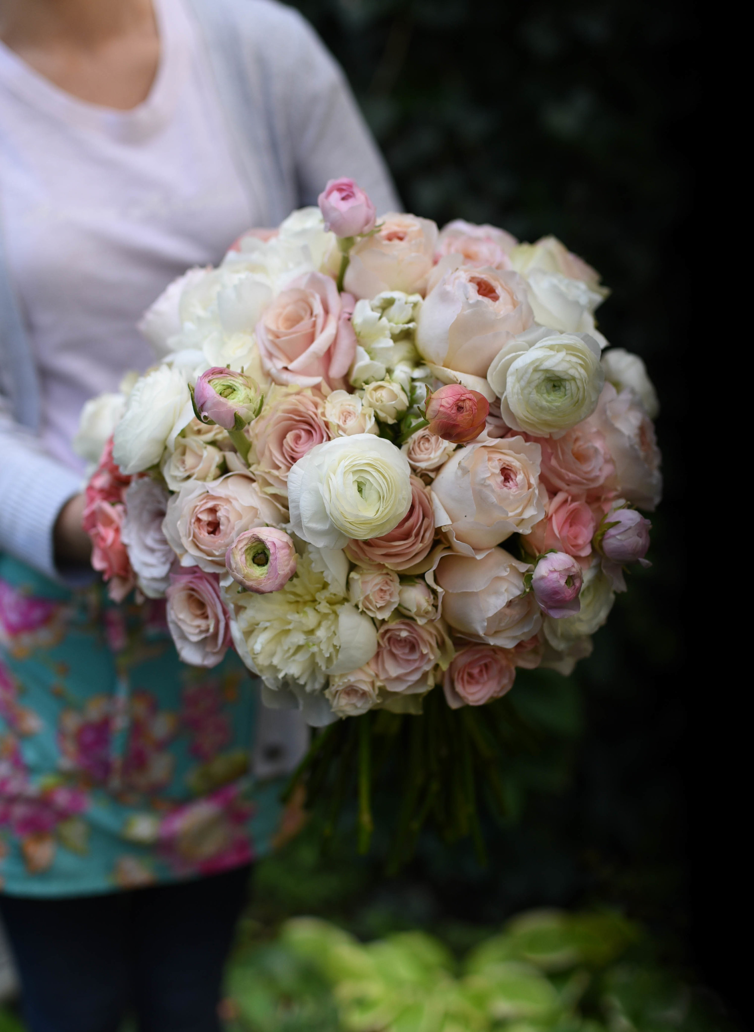 One of the girls holds the completed bouquet, showing just how enormous it is