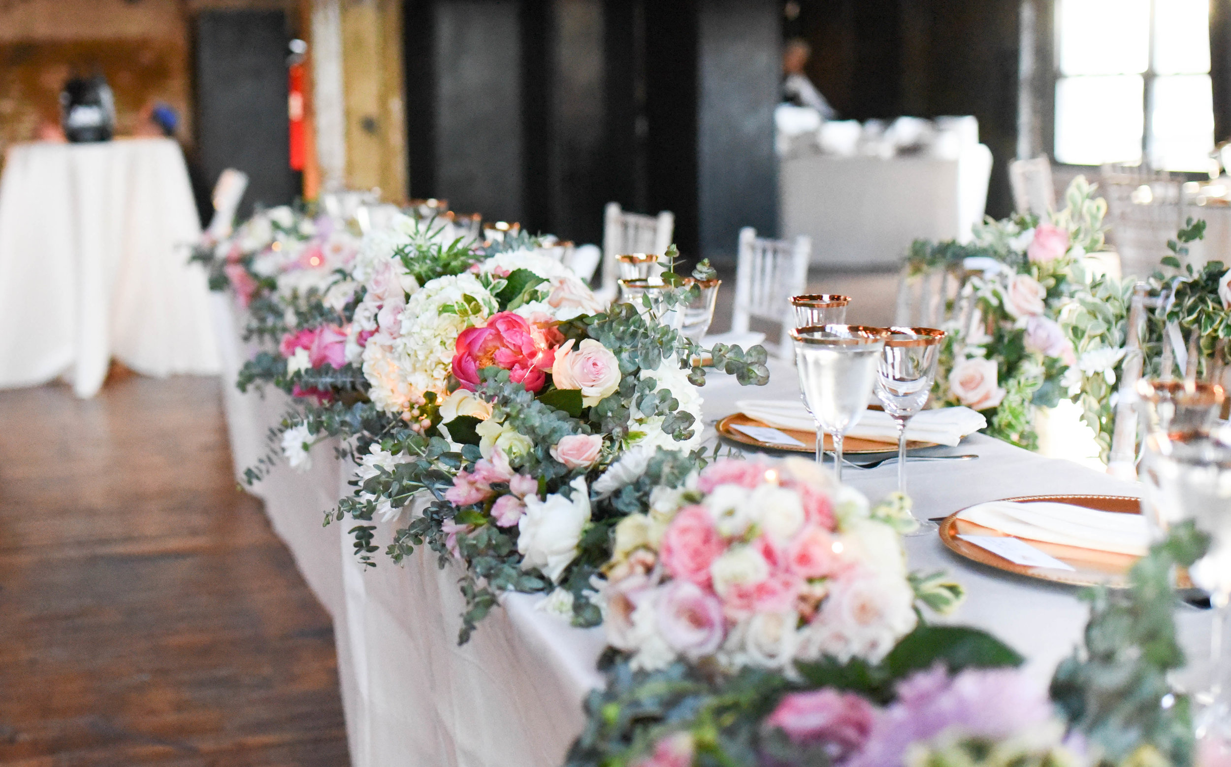 A stunning table garland of high end pink and white flowers