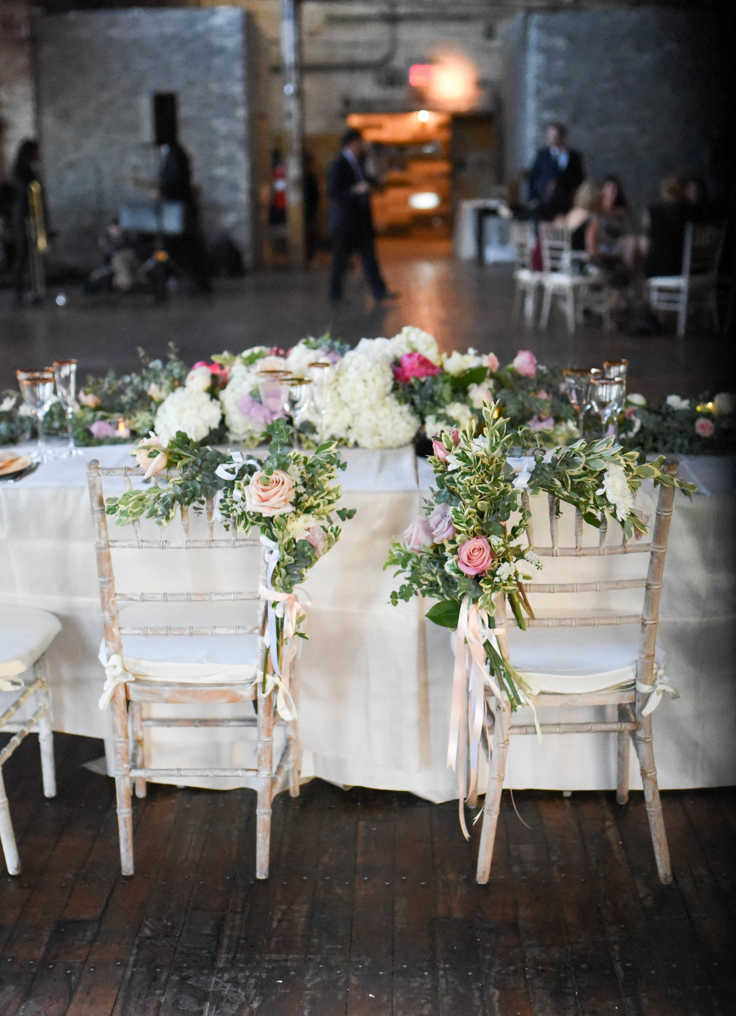 The rose chair decorations pair nicely with the table garland