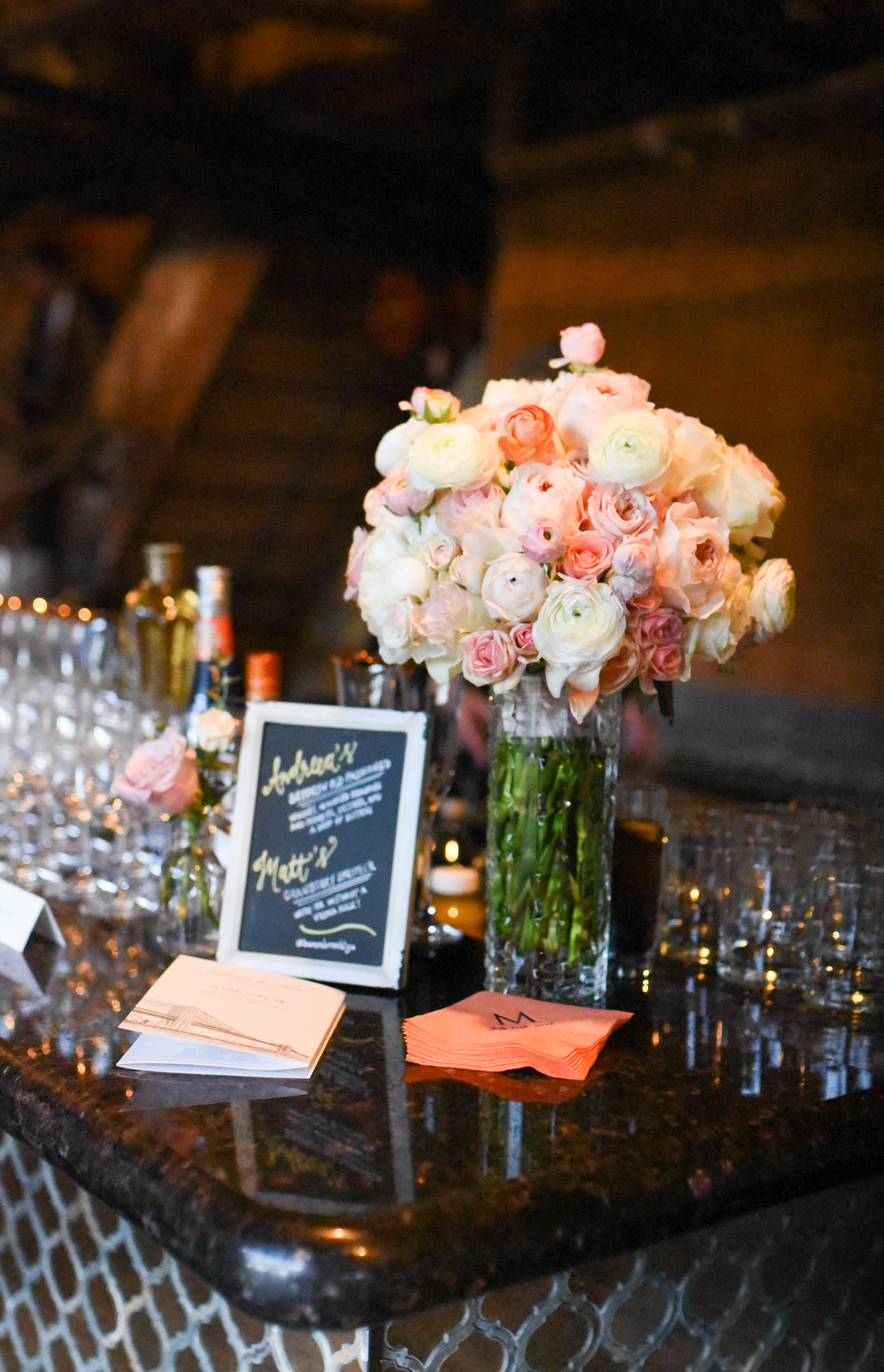 A pink and white bouquet next to the bar