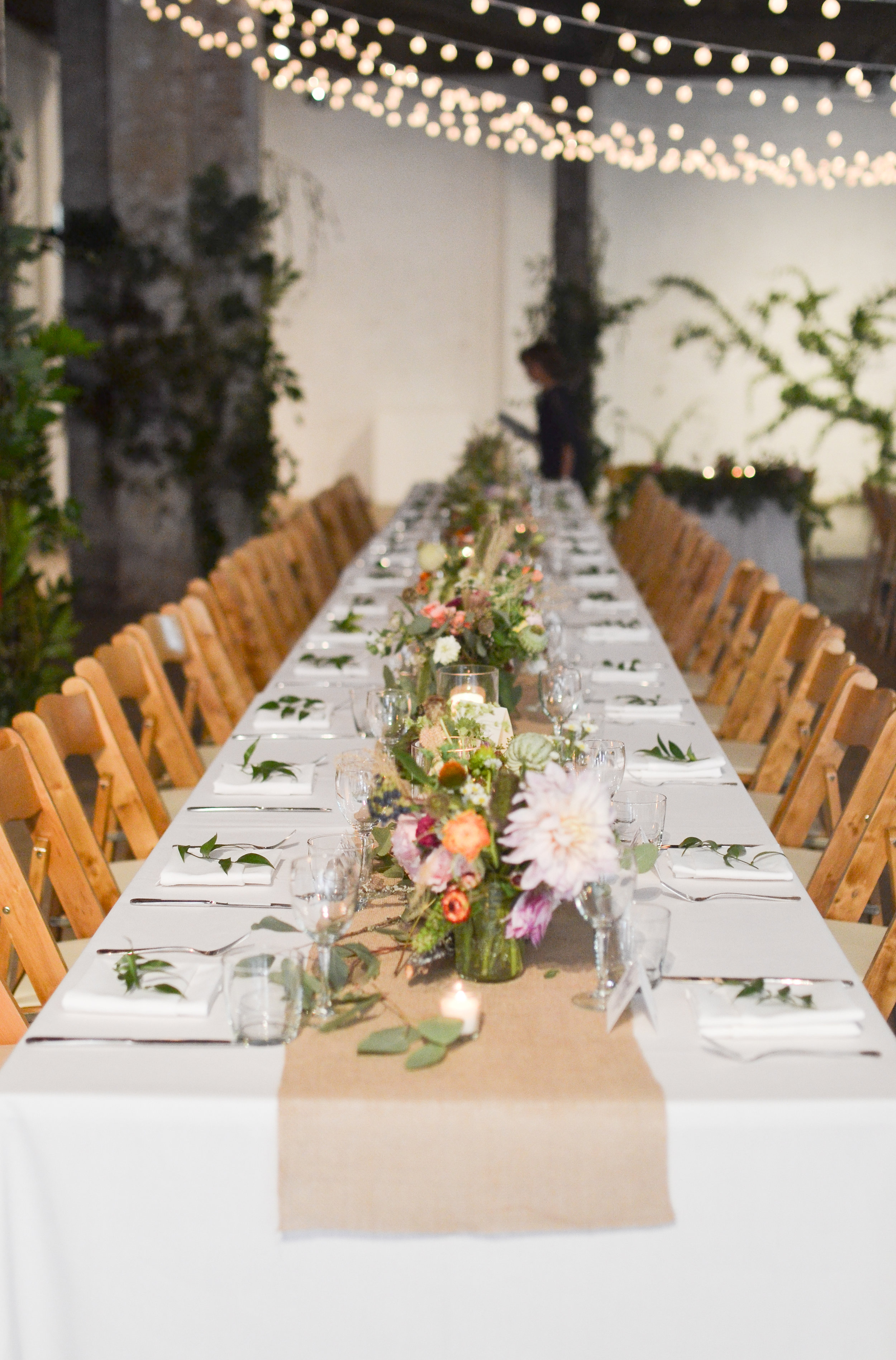 The table settings and centerpieces for the wild garden July wedding