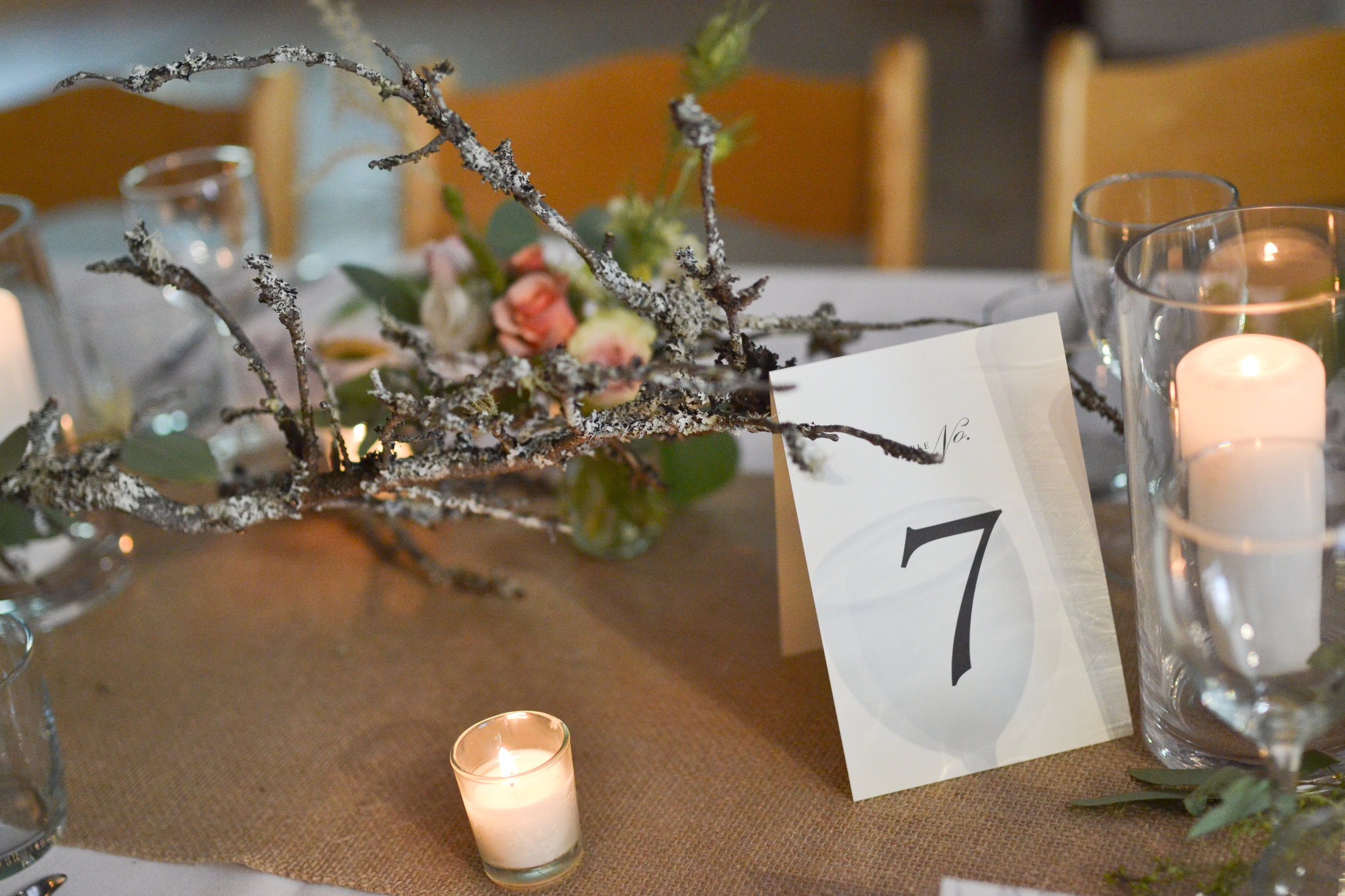Lichen covered branches pair well with the table cards