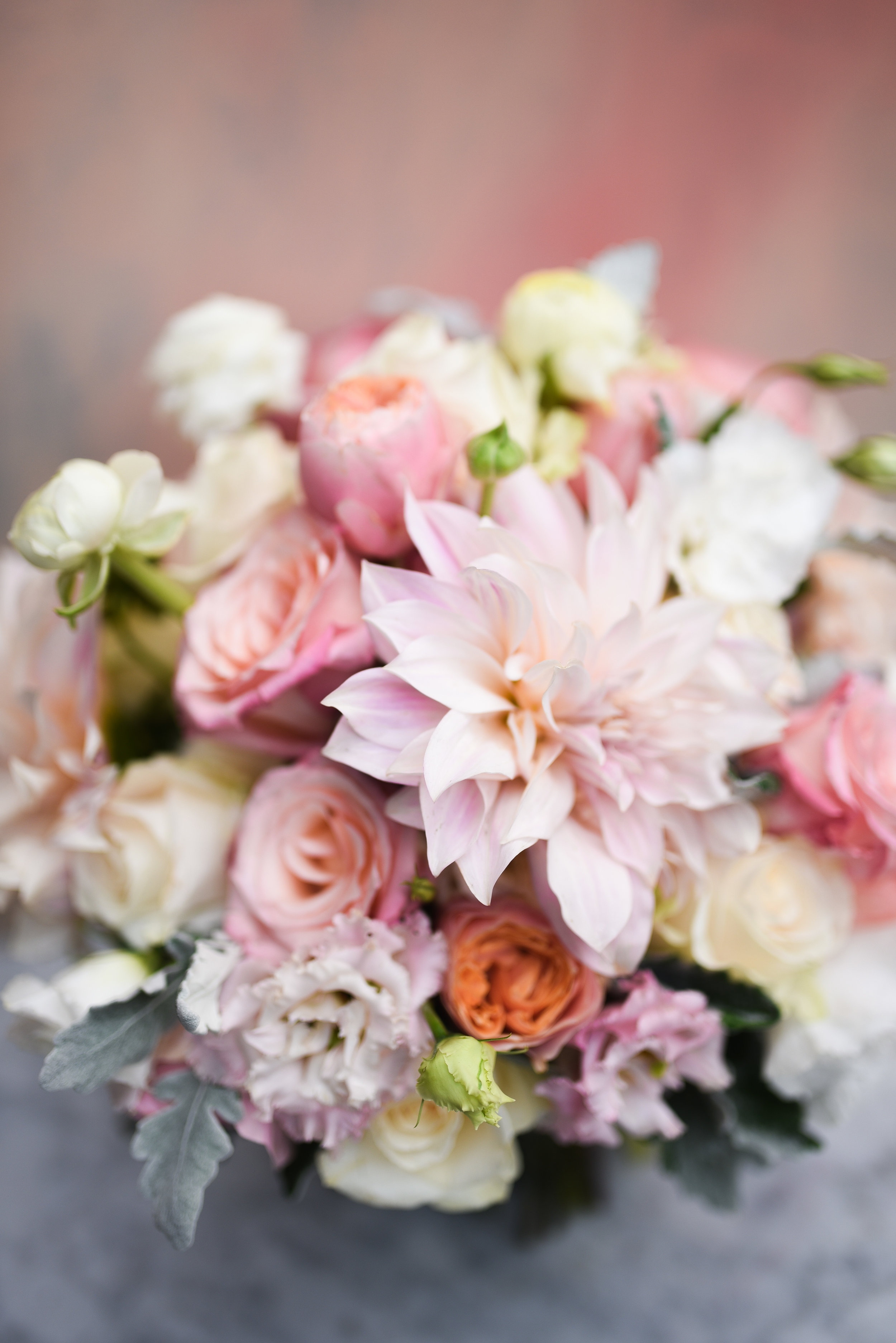 A stunning bridal bouquet of pale and blush pinks