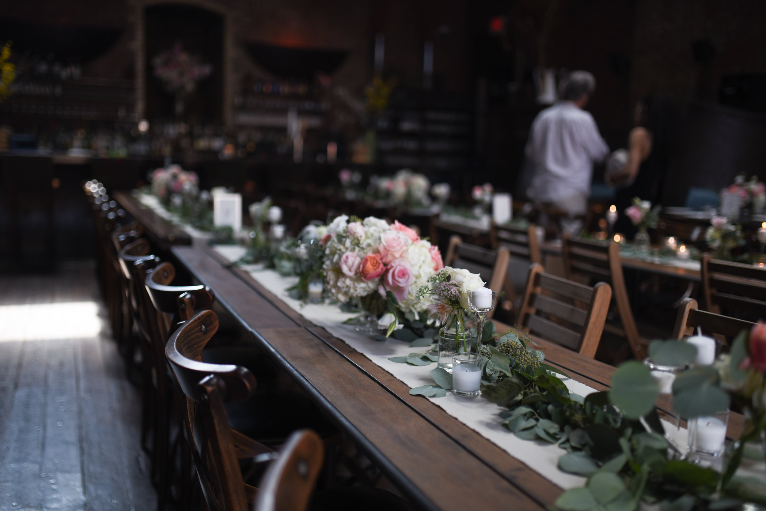 Lovely table settings for this wedding at MyMoon in Brooklyn - cascading garland, chalice centerpieces, and bud vases