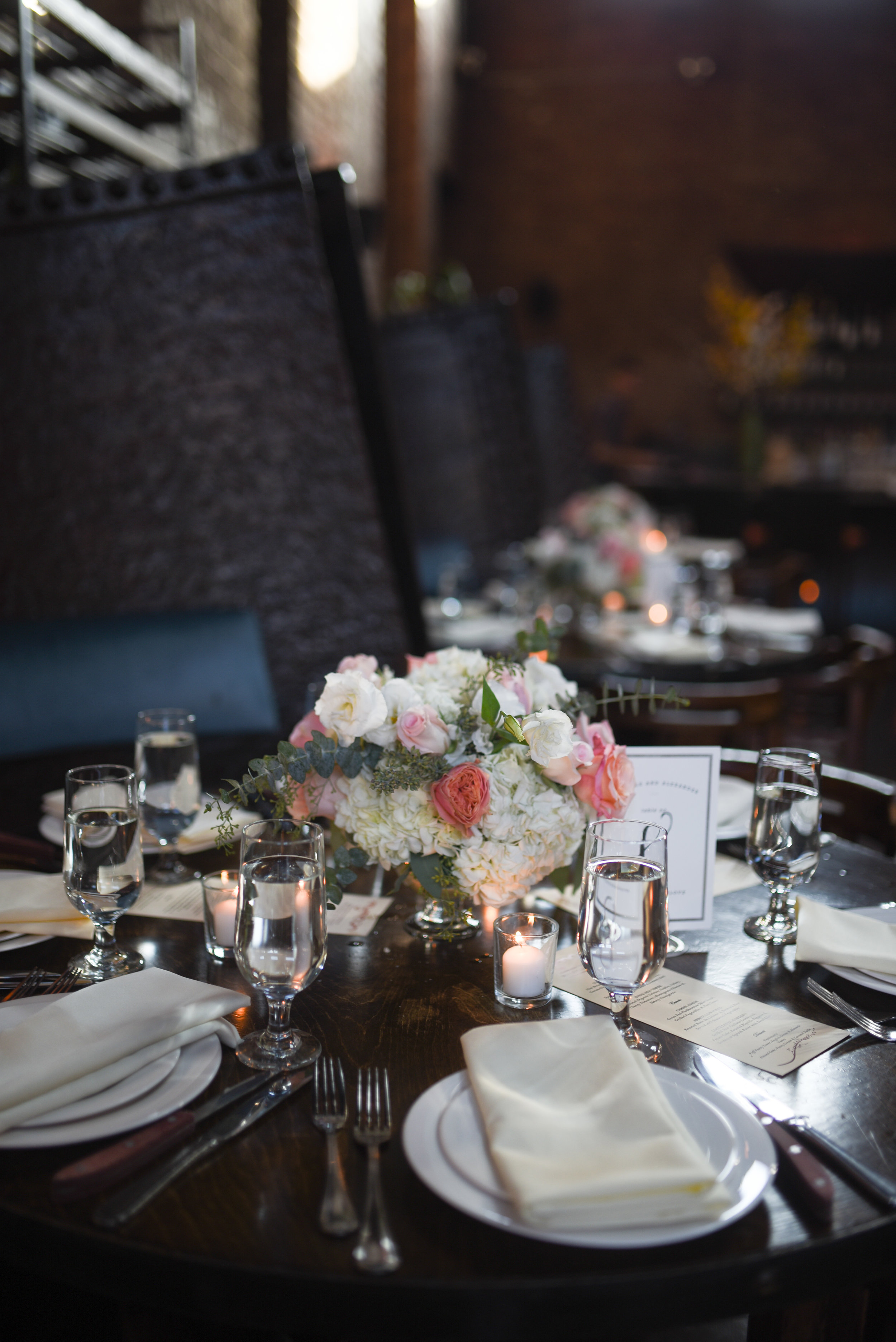 The booths at MyMoon look lovely with this soft pink chalice style centerpiece