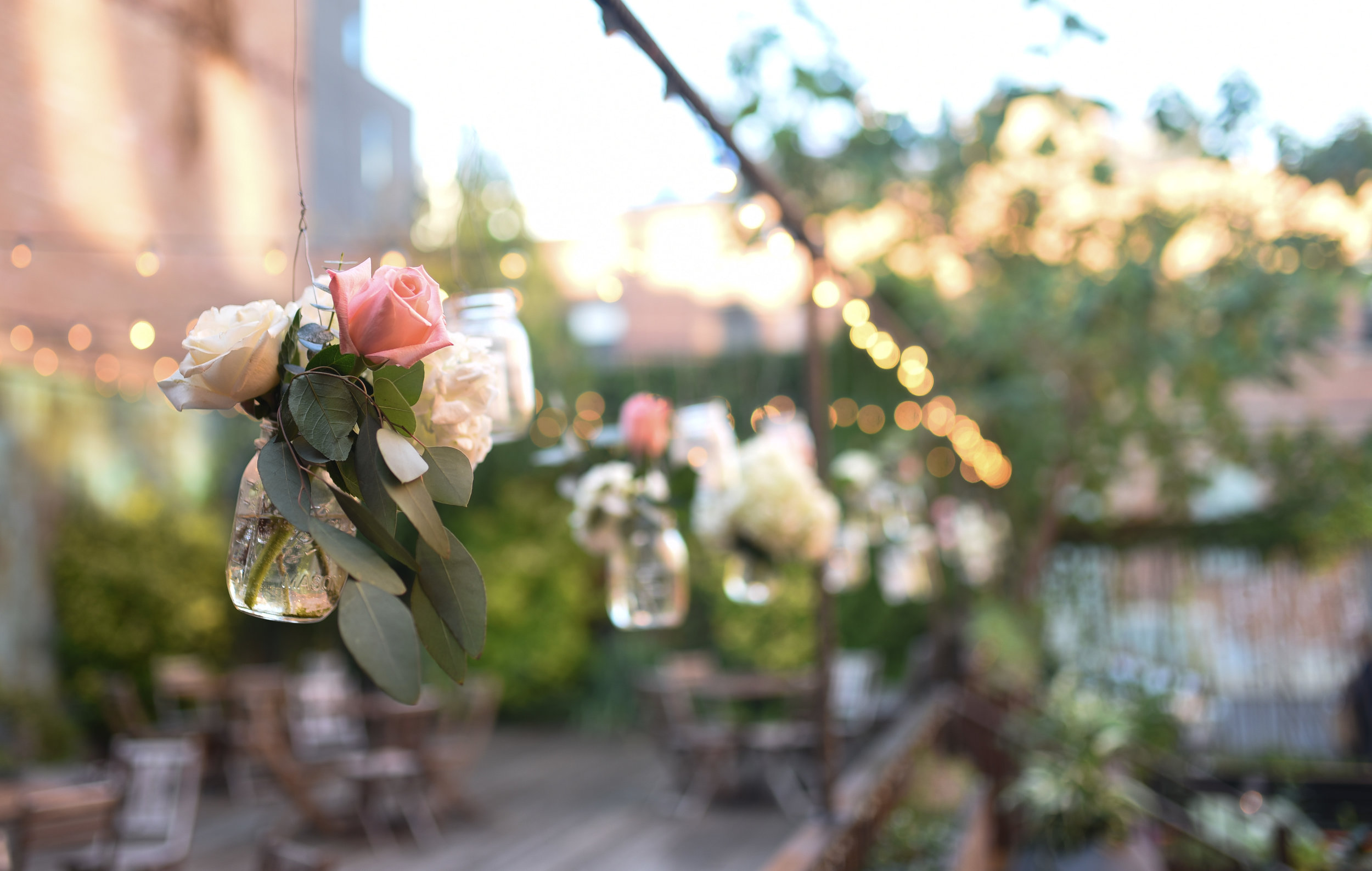 Hanging jars of roses and eucalyptus