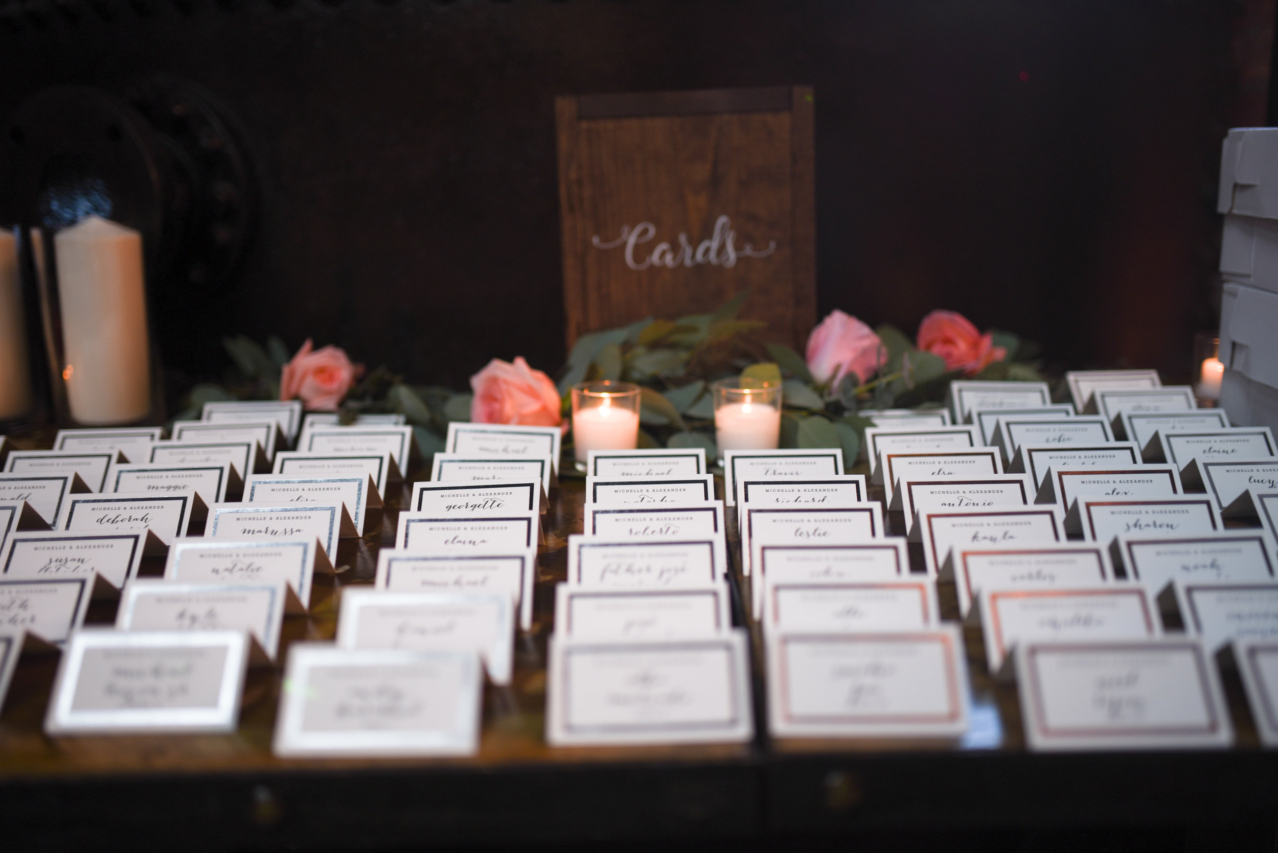 Eucalyptus and roses accent these lovely place cards