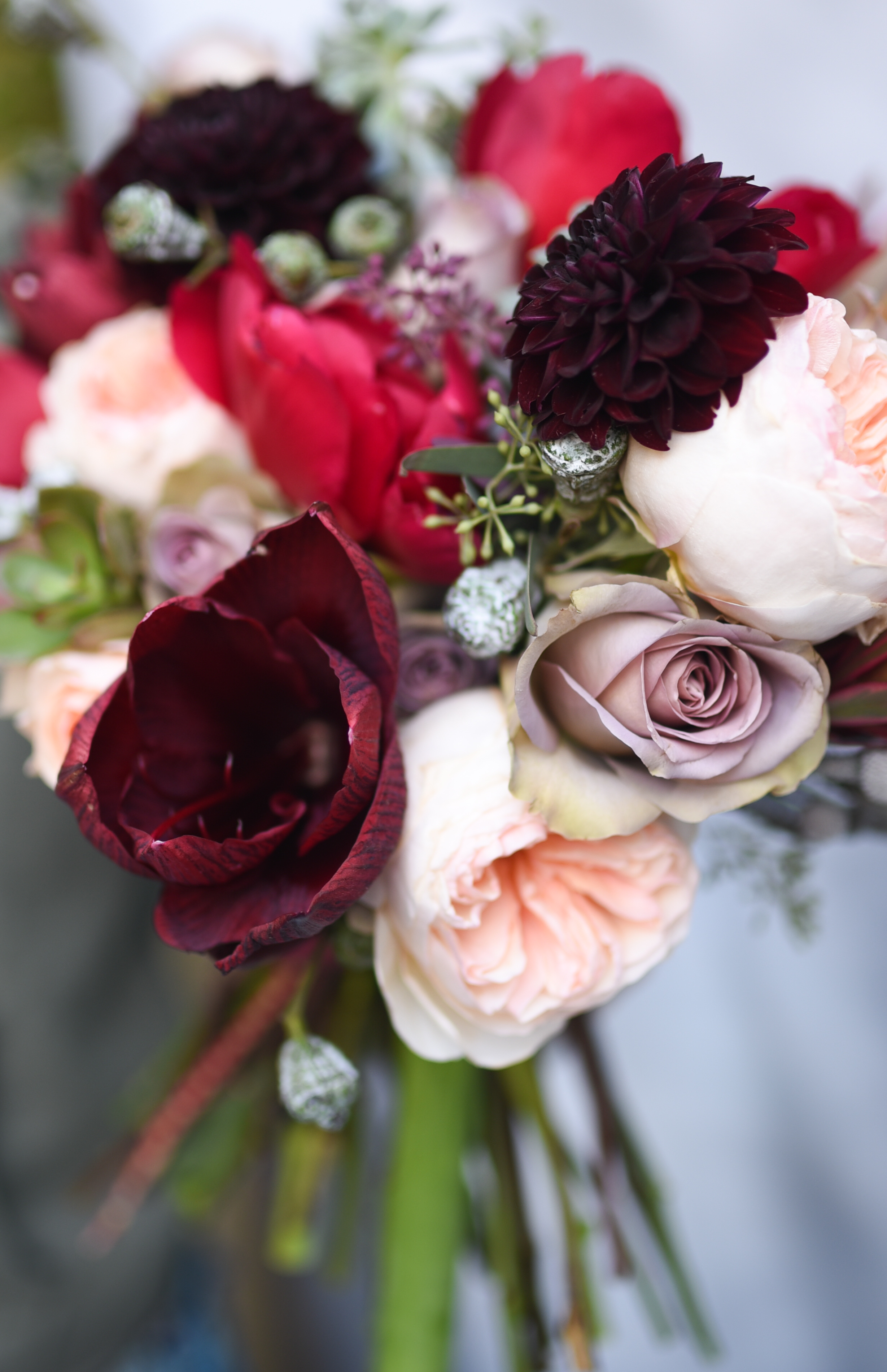 Amaryllis, dahlias, garden roses, peonies, roses, make the perfect bridal bouquet for mid fall