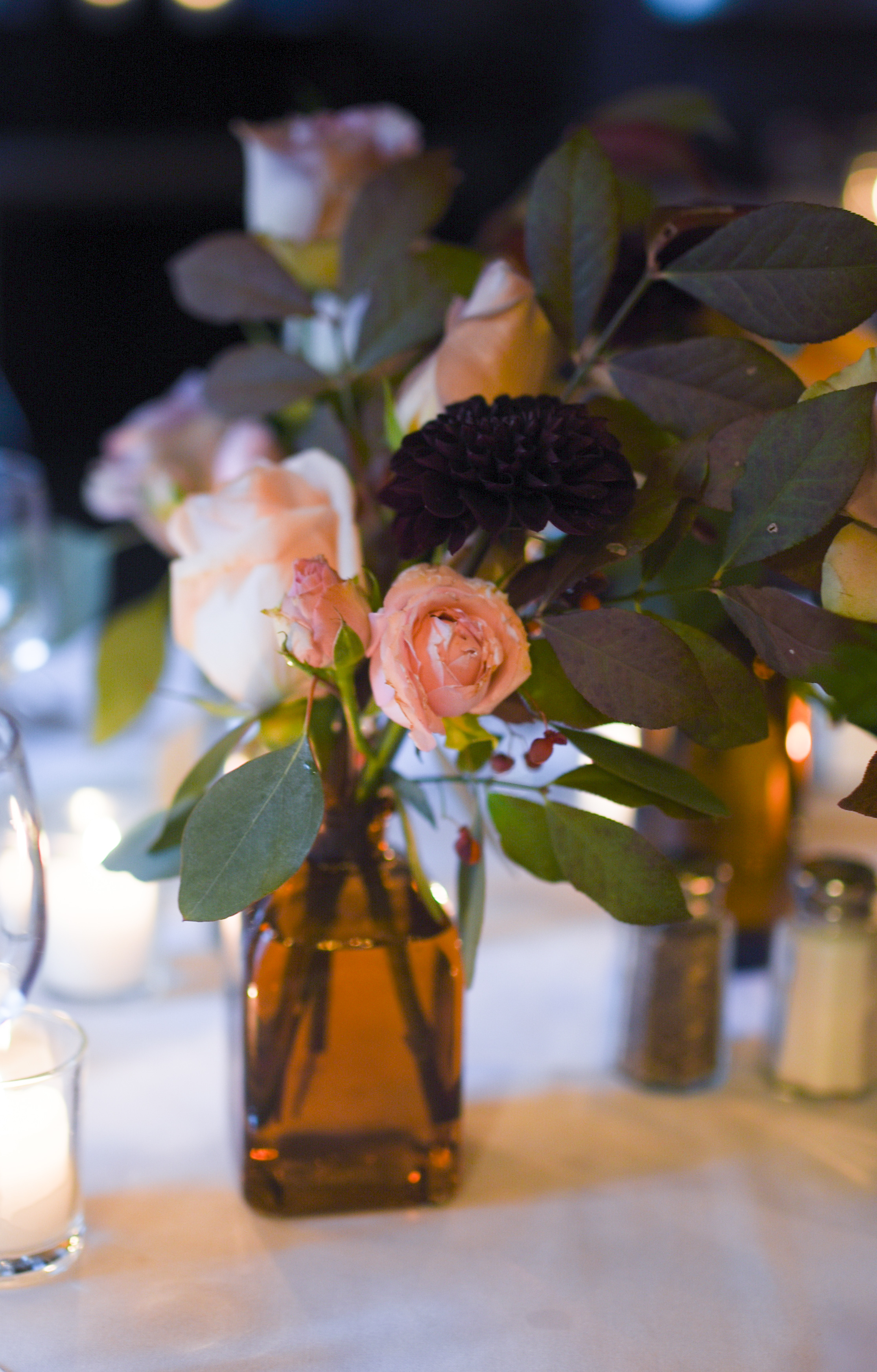 Another version of our amber bud vases - light pink flowers with deep foliage colors