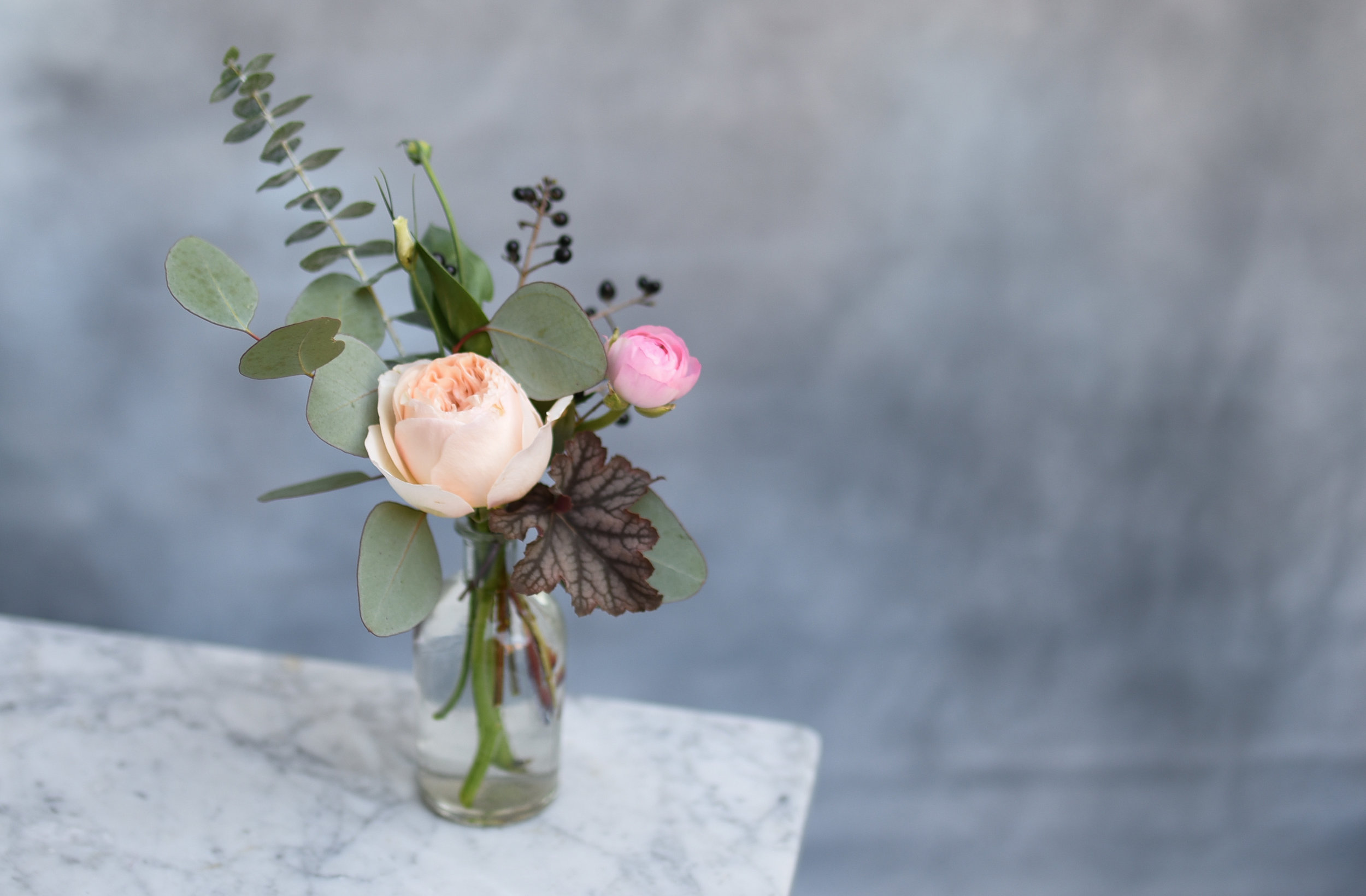 Garden roses and interesting greens for the bud vases