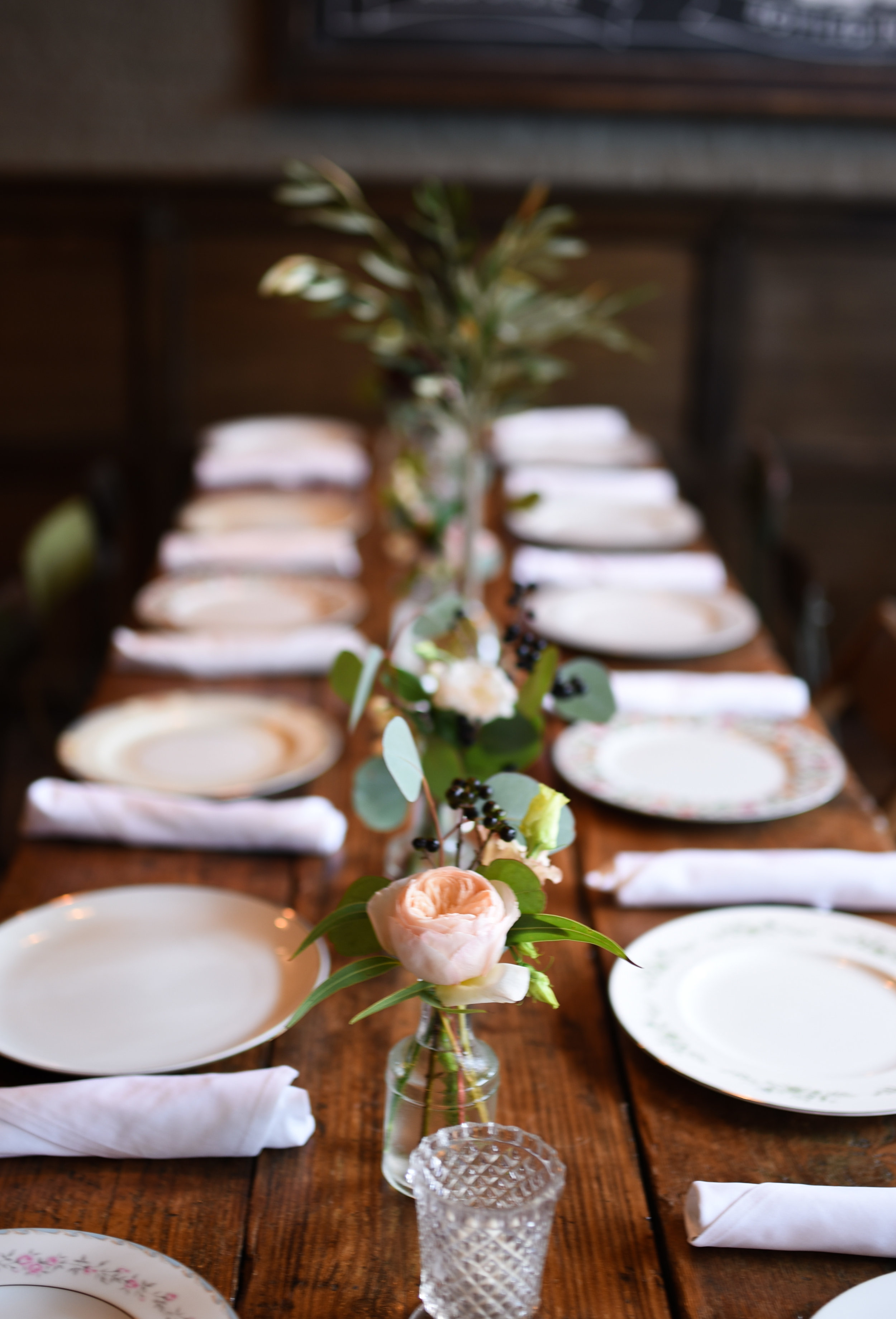 Bud vases down a long table at this Brooklyn baby shower