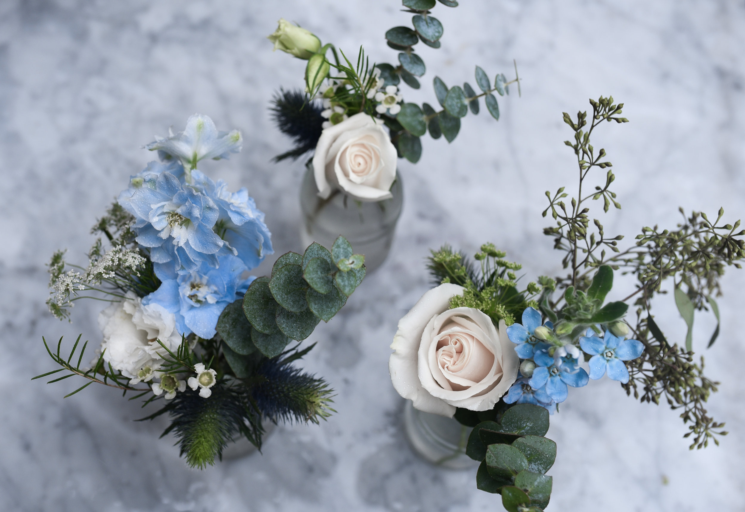Slight variations between the bud vases gave the arrangements a spontaneous and natural look