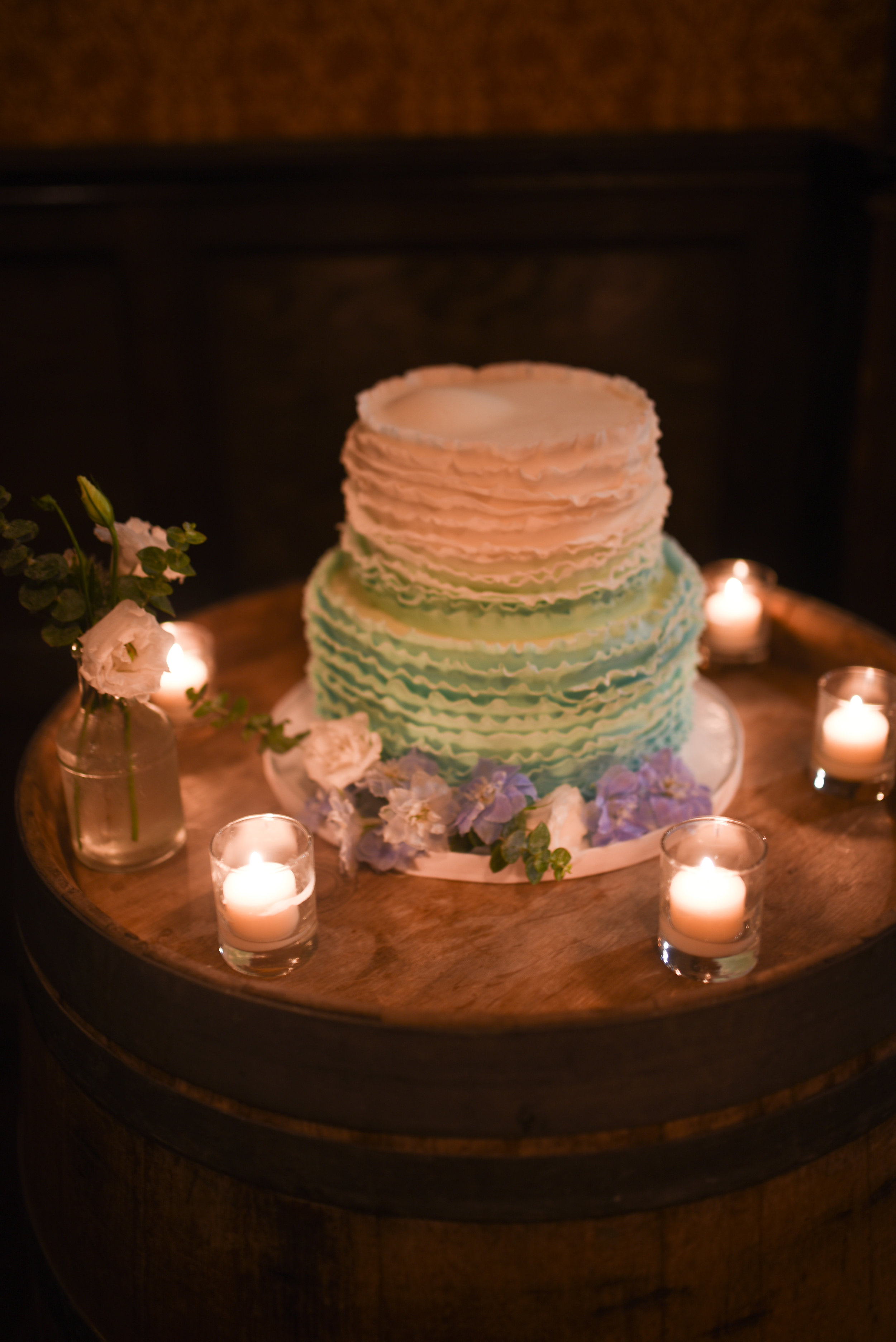 Lovely delphiniums pair with this elegant and feminine wedding cake