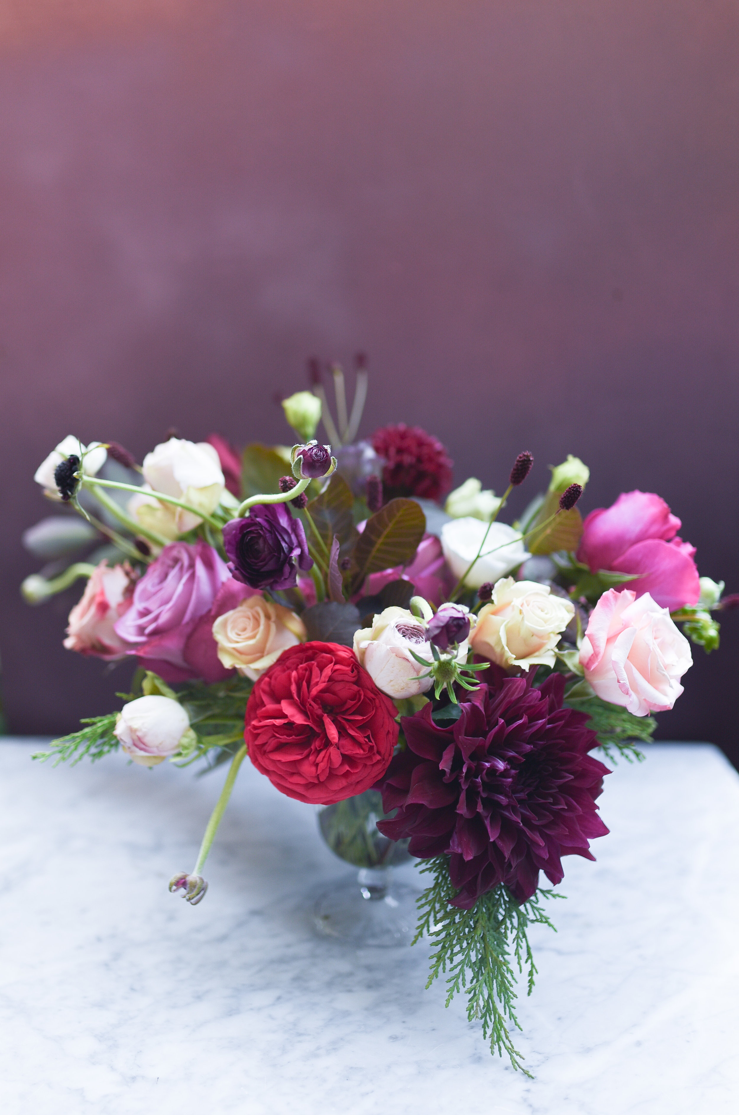 A gorgeous jewel tones flower arrngement for a Brooklyn Wedding reception at MyMoon