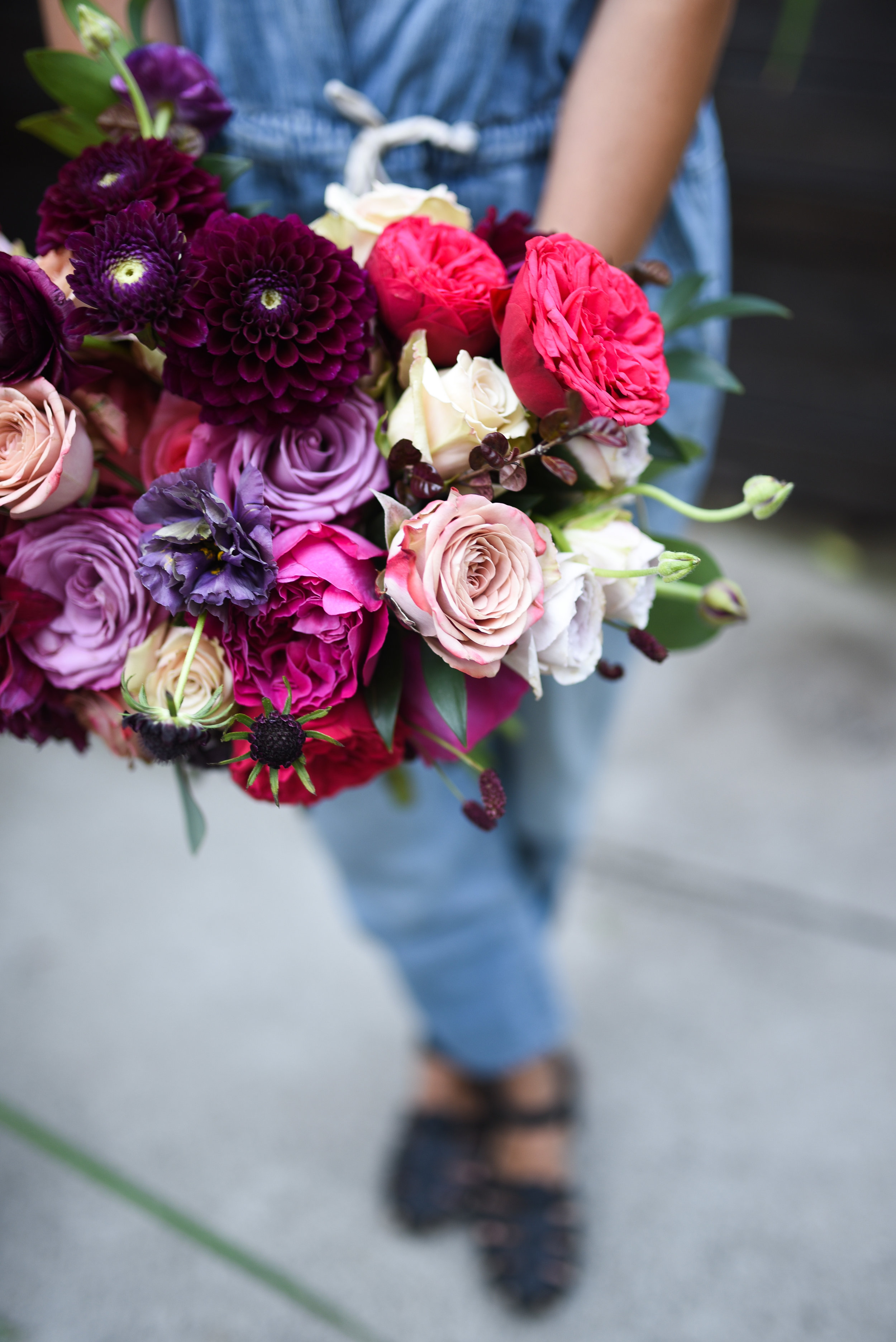 A closer shot of the final bridal bouquet being held up by one of the Rosehip girls