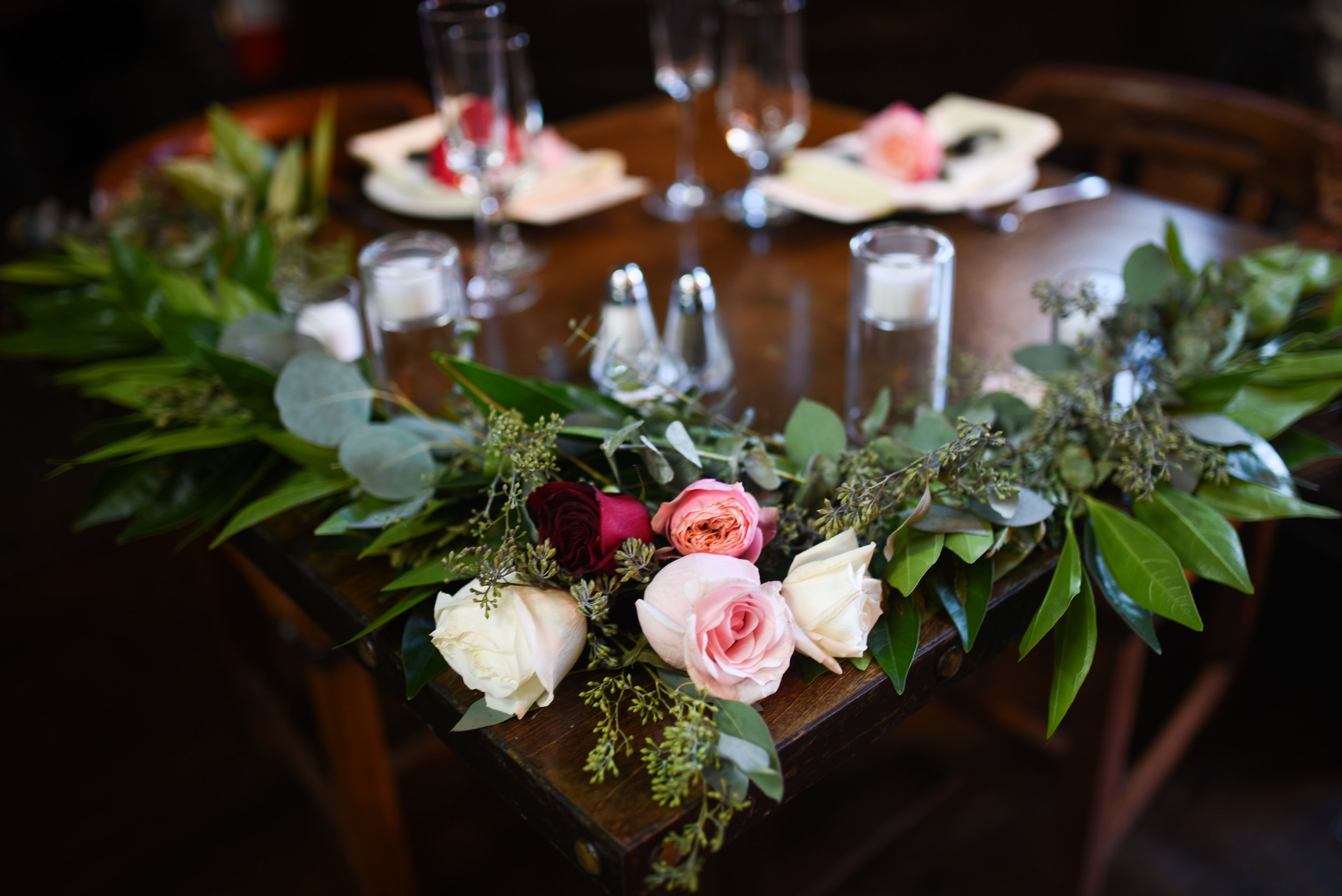 The sweetheart table at this jewel toned wedding in Brooklyn