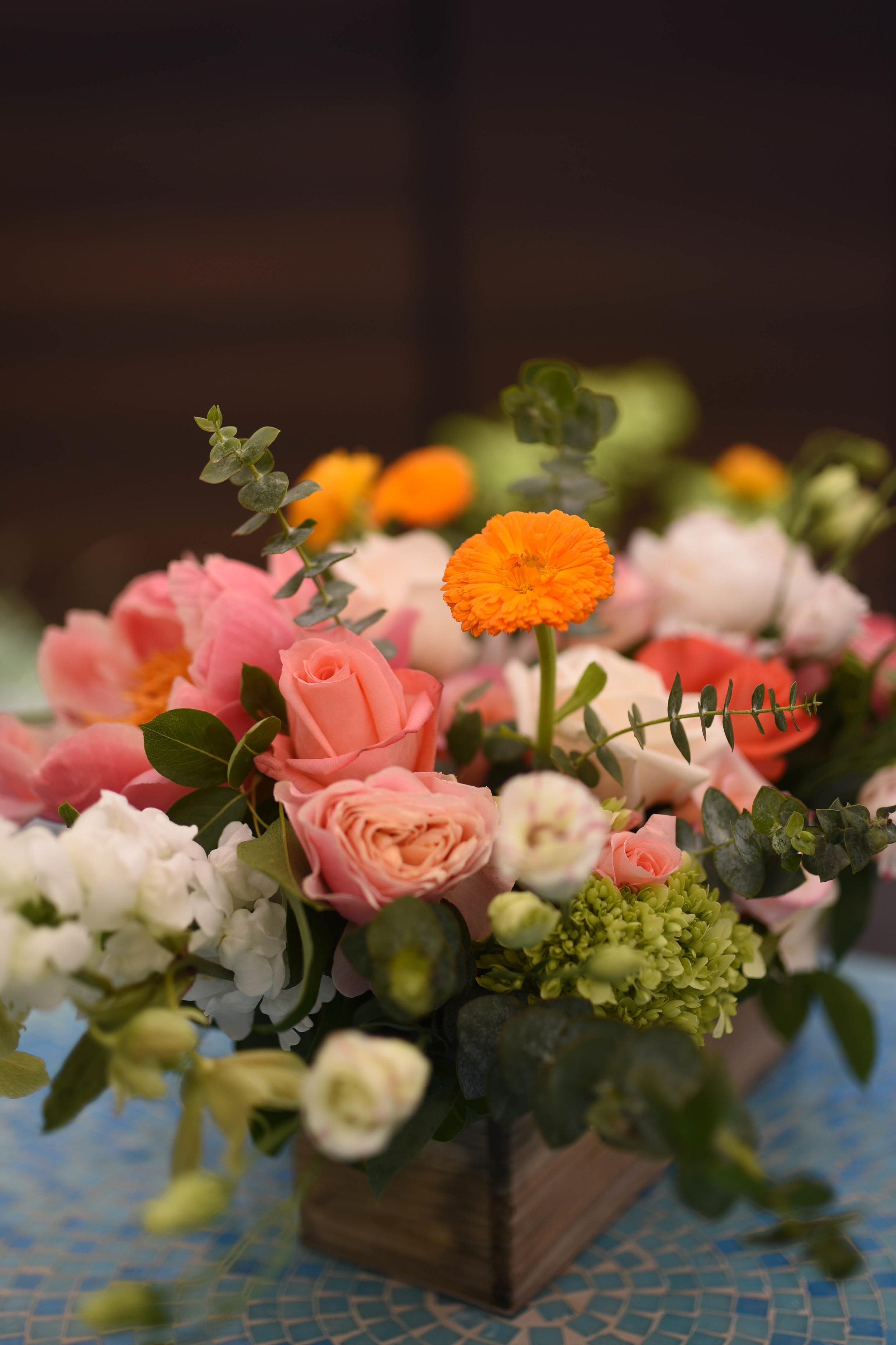 A variety of flowers and colors creates fun texture and a natural vibe for this Brooklyn wedding centerpiece