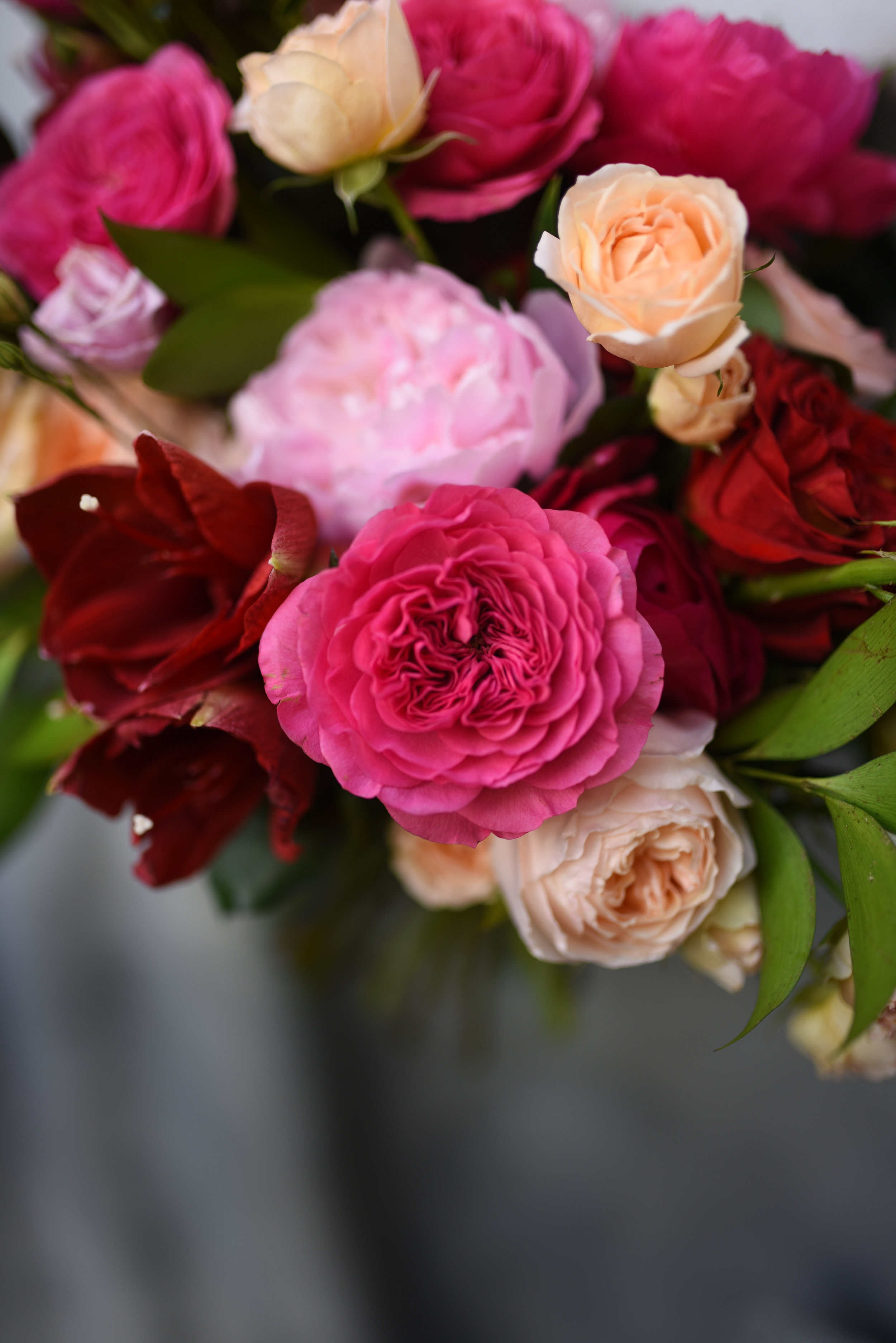 "David Austen's ""Baroness"" garden rose is featured in the bridal bouquet"
