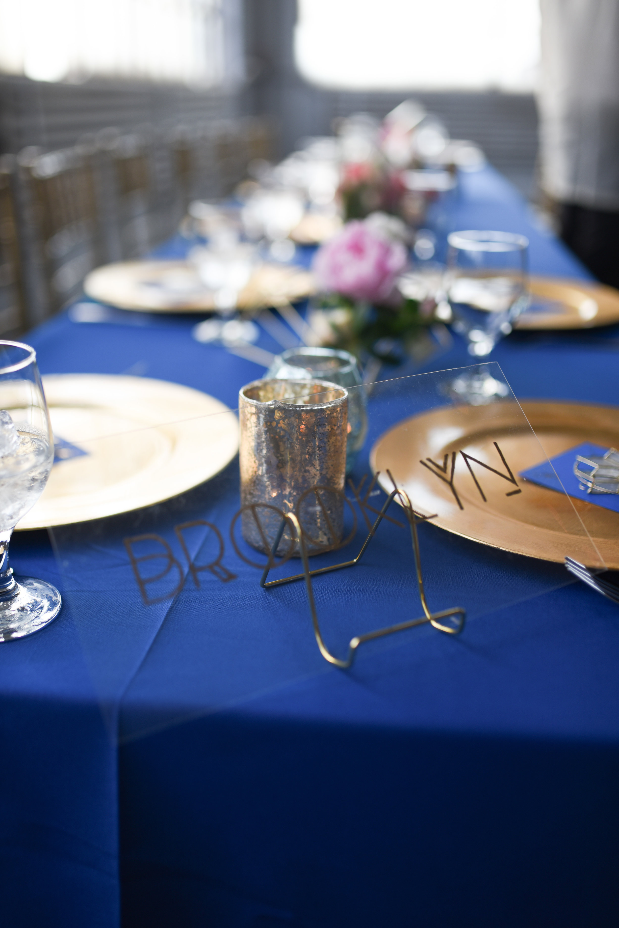 Table settings with the five boroughs