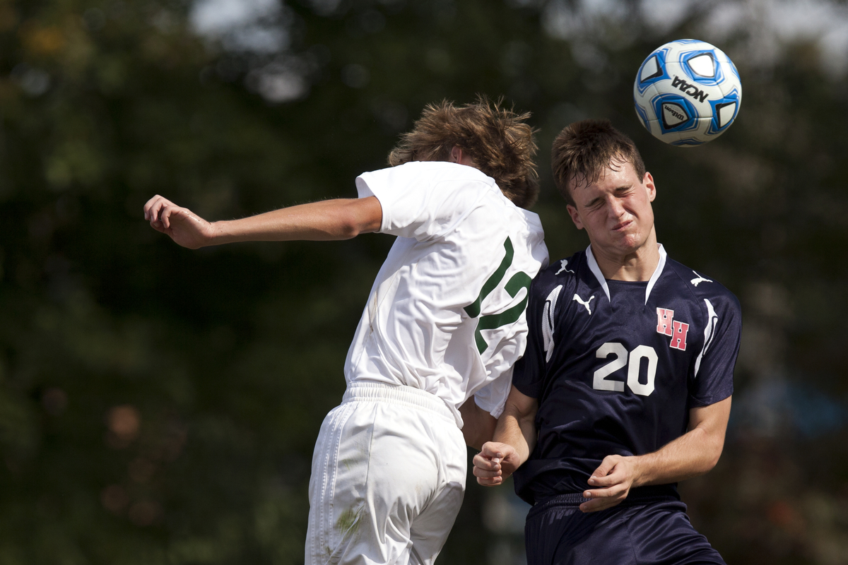 Forest Park's Alex Russell, left, and Heritage Hills' Torrin Madden head the ball during the Class 2A boys soccer sectional championship in Lincoln City, Ind. on Saturday, October 12, 2013. The Rangers won 2-1 in overtime.