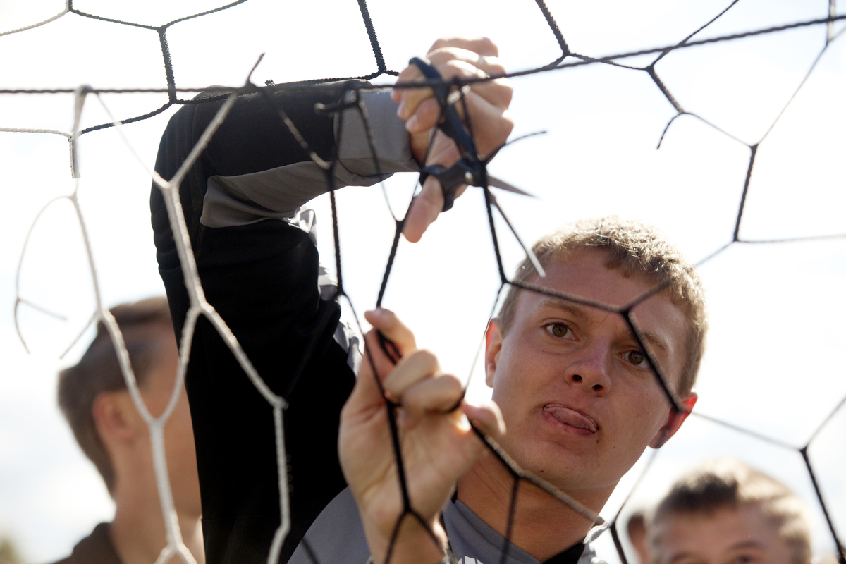 Forest Park's Blake Altmann cuts a piece of net after the Rangers won the Class 1A soccer regional championship against Washington Catholic in Fort Branch, Ind.on October 19, 2013.