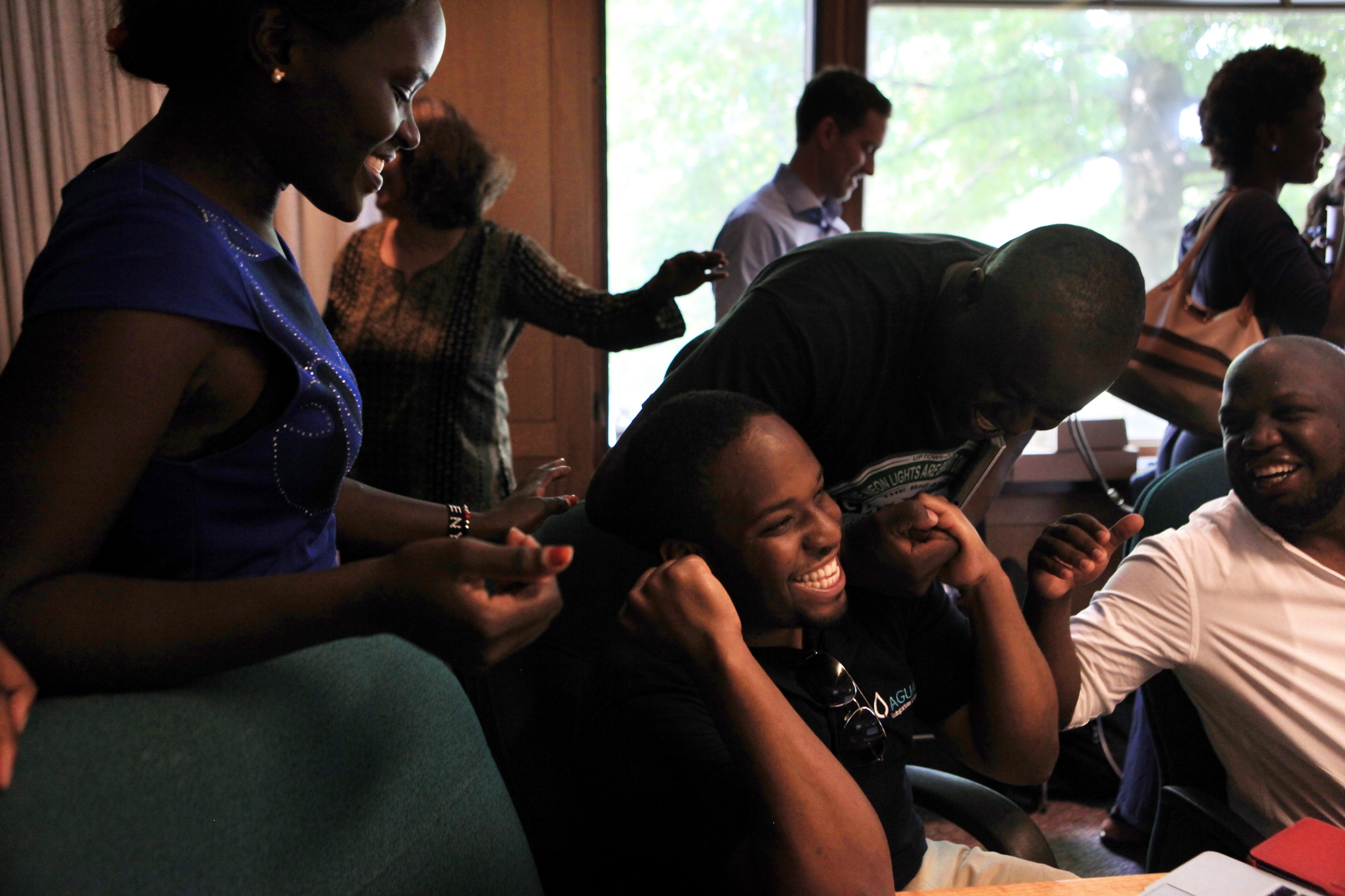 Lydia Munika, of Kenya, left, Bruce Ernest, of Zambia, second from right, and Tumiso Mabusela, of Botswana, right, congratulate Mshila Sio, of Kenya, middle, after he learned that he received a grant during the last week of the Young African Leaders Initiative at Dartmouth College in Hanover, N.H. on July 23, 2014.