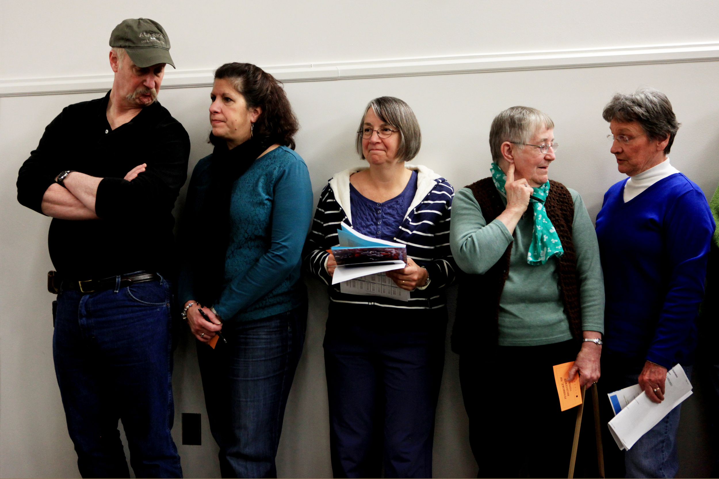 From left: Chuch Schmidt, his wife Denise, Sara Smith, Ann Hasbany and Marie Brezosky line up to vote by ballot on amendment four during the Pembroke Town Meeting at Pembroke Academy on Saturday, March 15, 2014.
