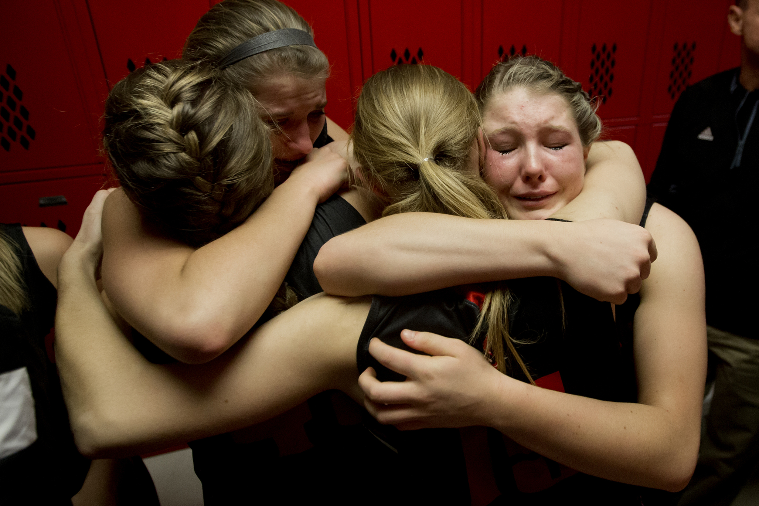 Southridge's Tori Tretter, right, Kadie Dearing, Taylor Neukam and Kendyl McKeough comfort each other after losing to Vincennes Lincoln in the Class 3A girls basketball sectional championship in Princeton, Ind. on Feb. 6, 2016. The Raiders lost 48-39.