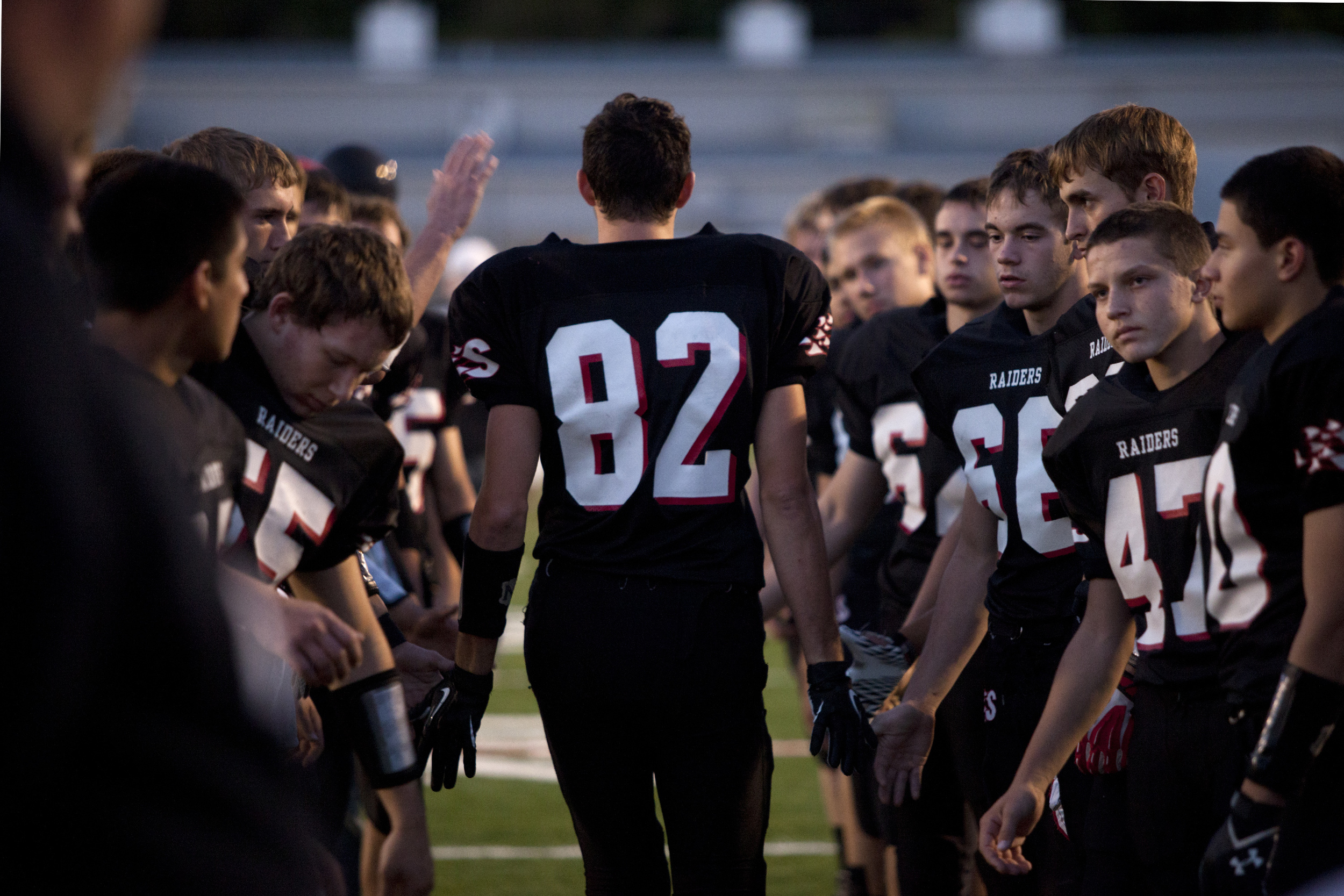 Southridge's Cody Thompson walks through a line of his teammates as he was introduced for senior night before the game against Gibson Southern at Raider Field in Huntingburg, Ind. on Oct. 18, 2013. The Raiders lost 31-21.