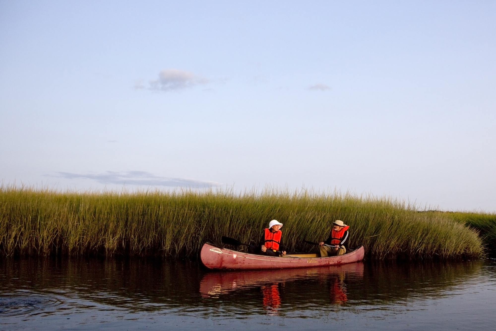 Canoers look for birds and other marsh life during a sunset canoe tour at the Scarborough Marsh Nature Center in Scarborough, Maine on August 25.