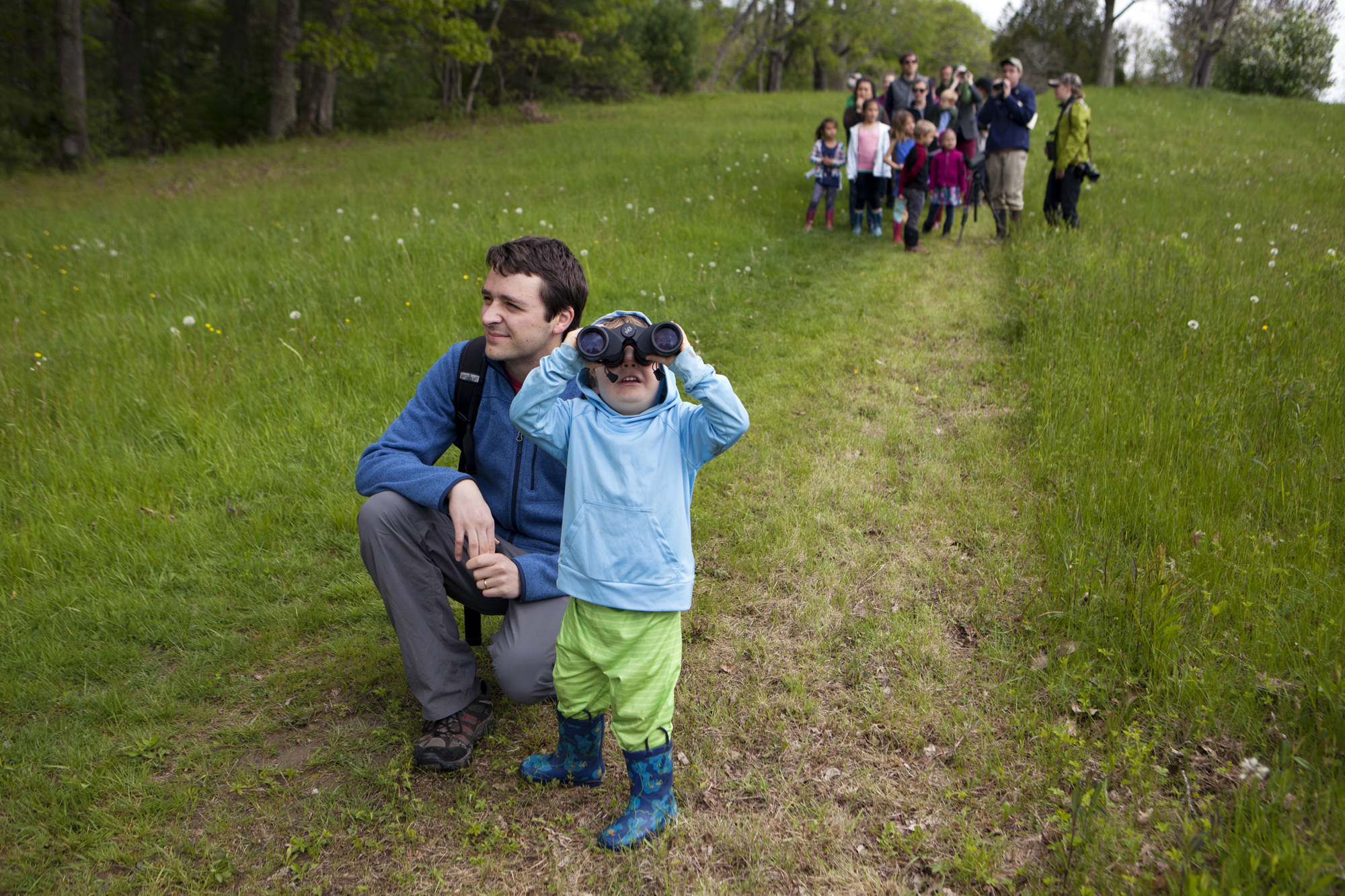 Kids look for birds during the LL Bean Birding Festival's children's bird walk at Pettengill Farm in Freeport, Maine on May 27.