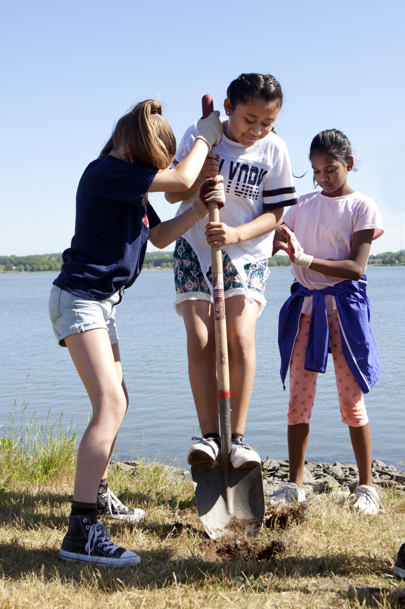 King Middle School seventh graders plant native plants around Back Cove in Portland, Maine as part of Maine Audubon's Bringing Nature Home initiative on June 13.