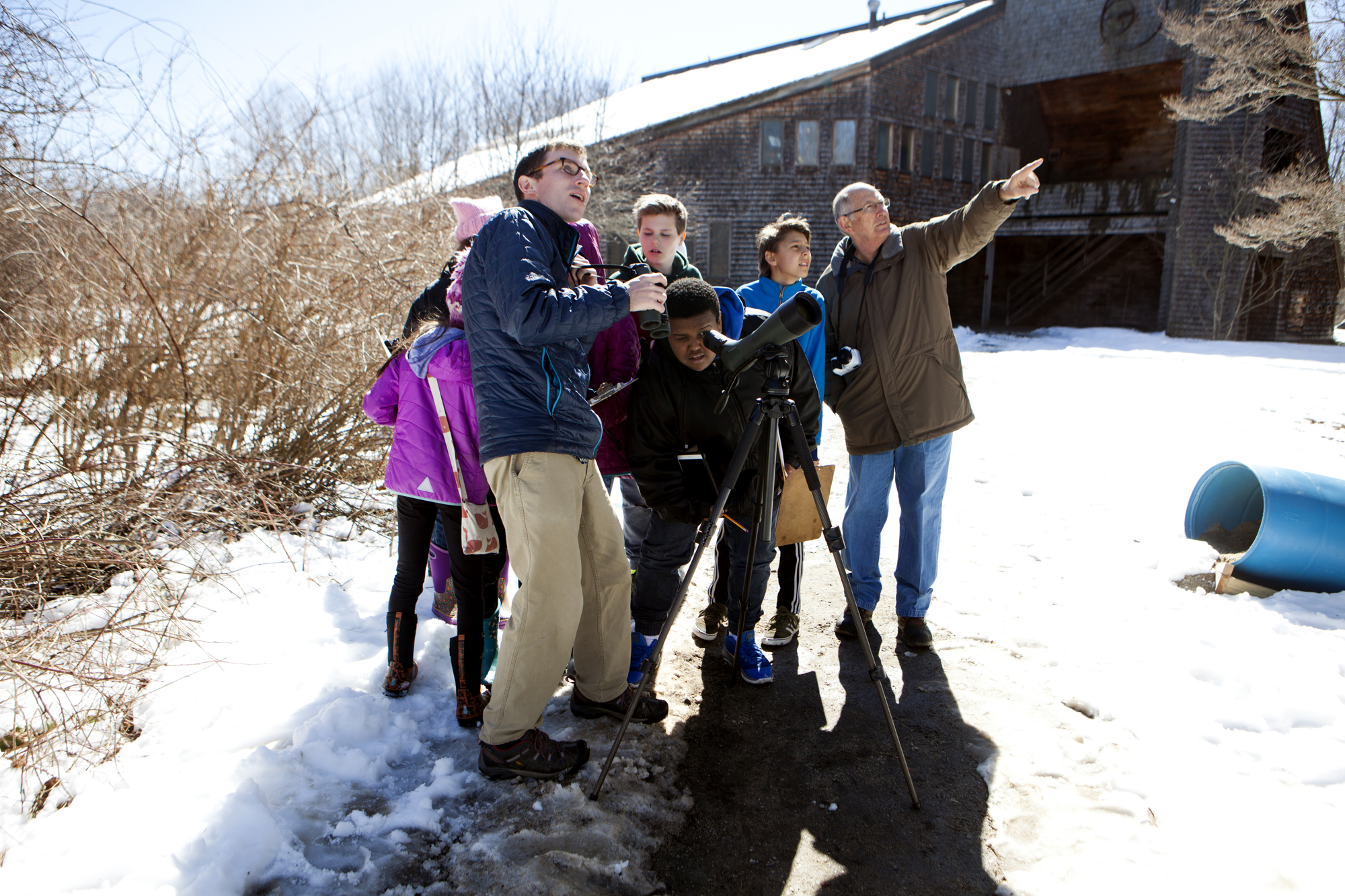 Maine Audubon Staff Naturalist Doug Hitchcox leads a bird walk for King Middle School students at Gilsland Farm Audubon Center in Falmouth, Maine on April 3.