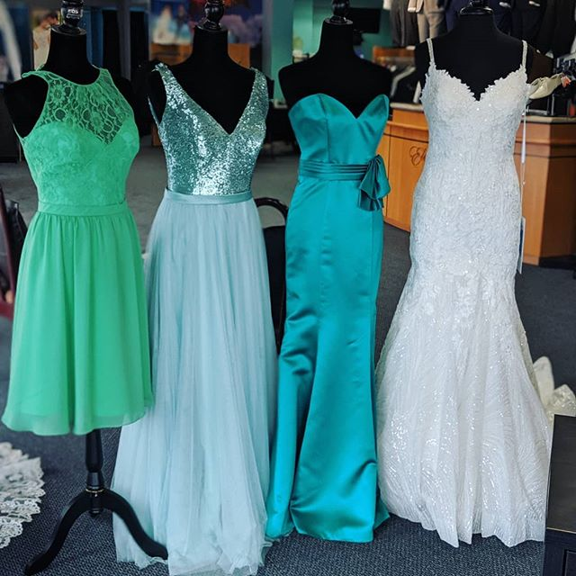 The gang's all here 💃✨ Switching up our window display with some pops of color for spring and summer!  #eleganzagallery #allurebridals #allurebridesmaids #sparkle #bridesmaids #green #teal #dresses #bridal #bridetobe