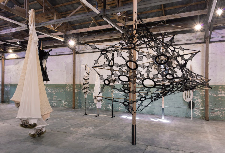 (on right) Foile a Deux,  Lara Schnitger , 2016. An incredible piece made from nylon (presumably pantyhose), chopsticks and wood, the geometry of the resulting shapes are completely captivating.