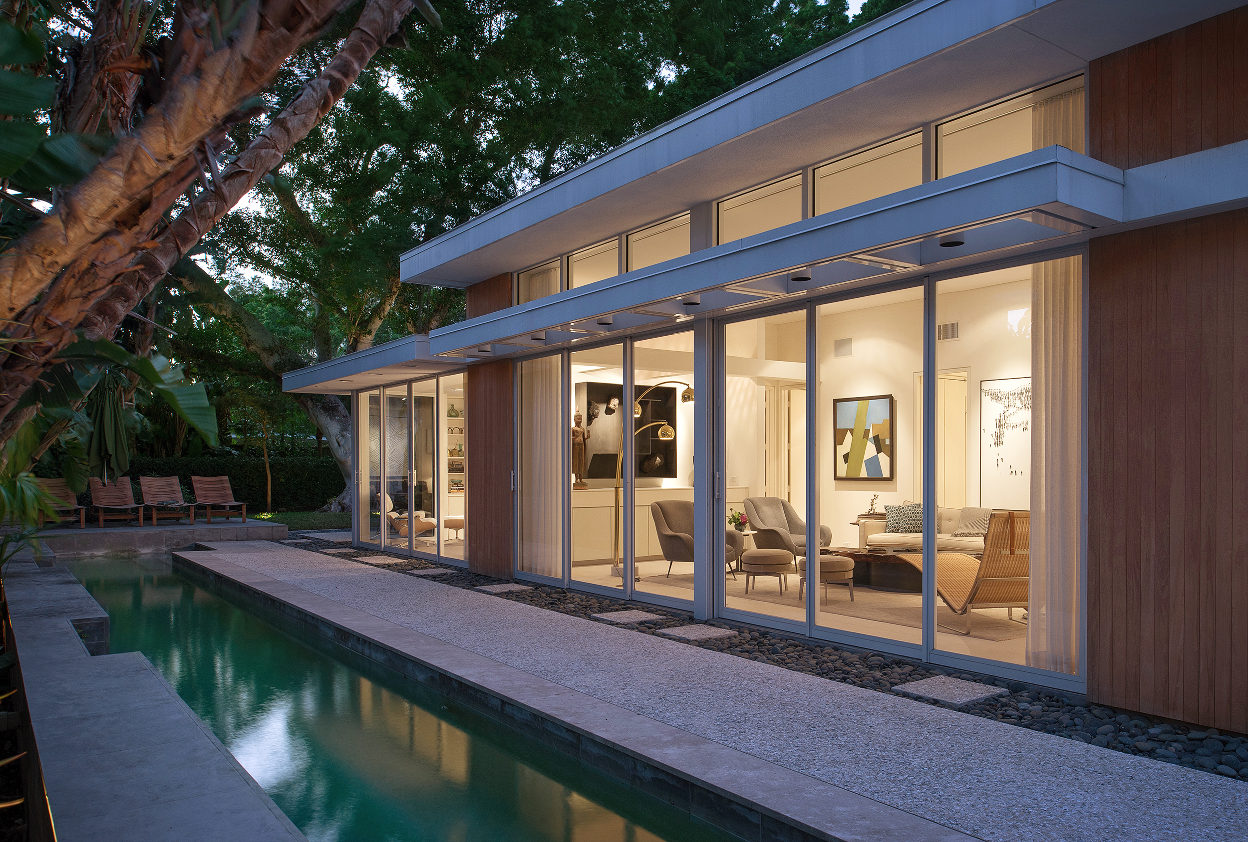 William-Rupp-Pavilion-House---Exterior-Late-Dusk-Pool-and-Living_warm.jpg